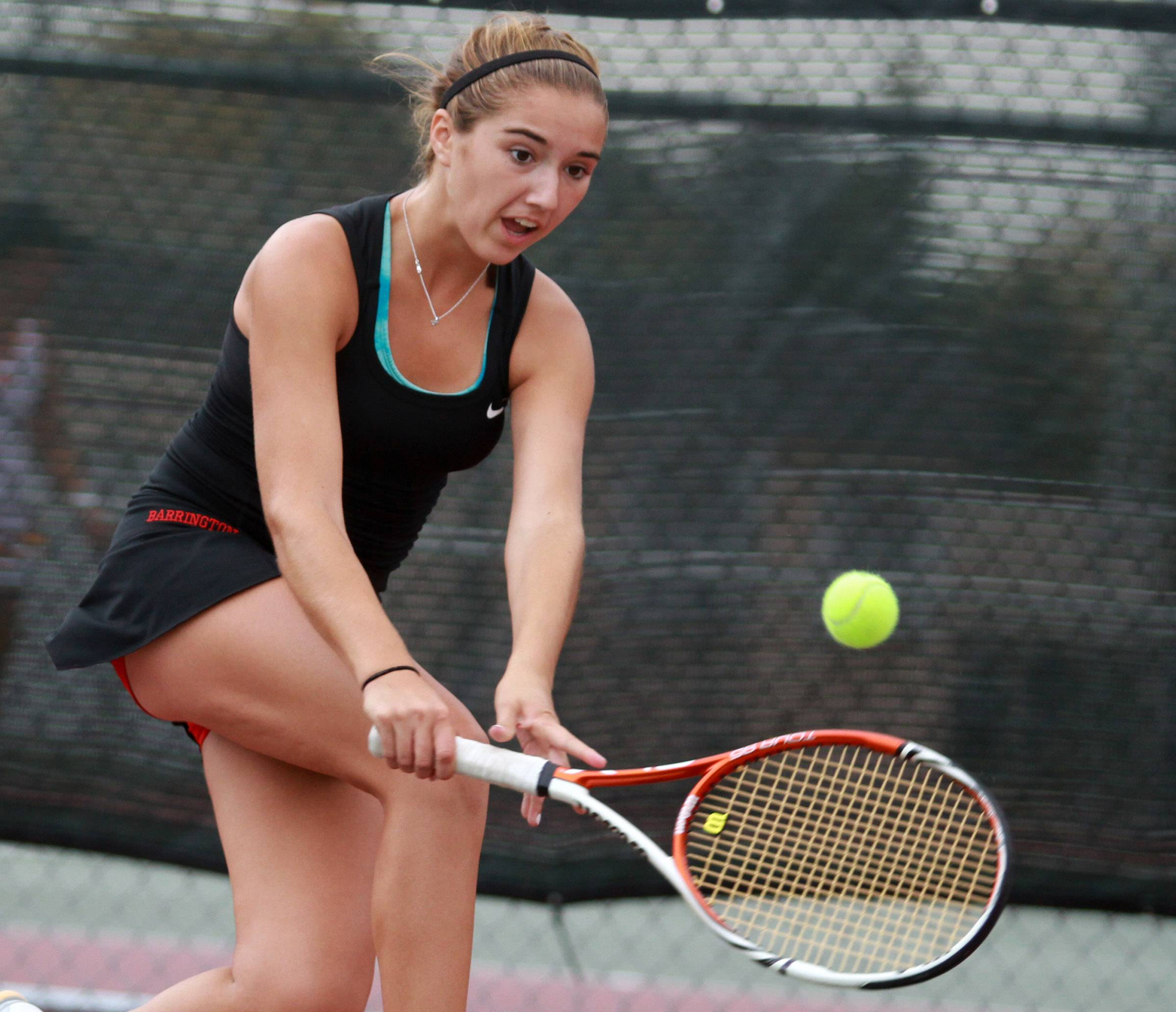 Barrington's Michelle Linden competes against Elk Grove Village's Jelena Vujanic at No. 1 singles in last season's MSL tournament at Rolling Meadows. Both players return for their teams this fall.