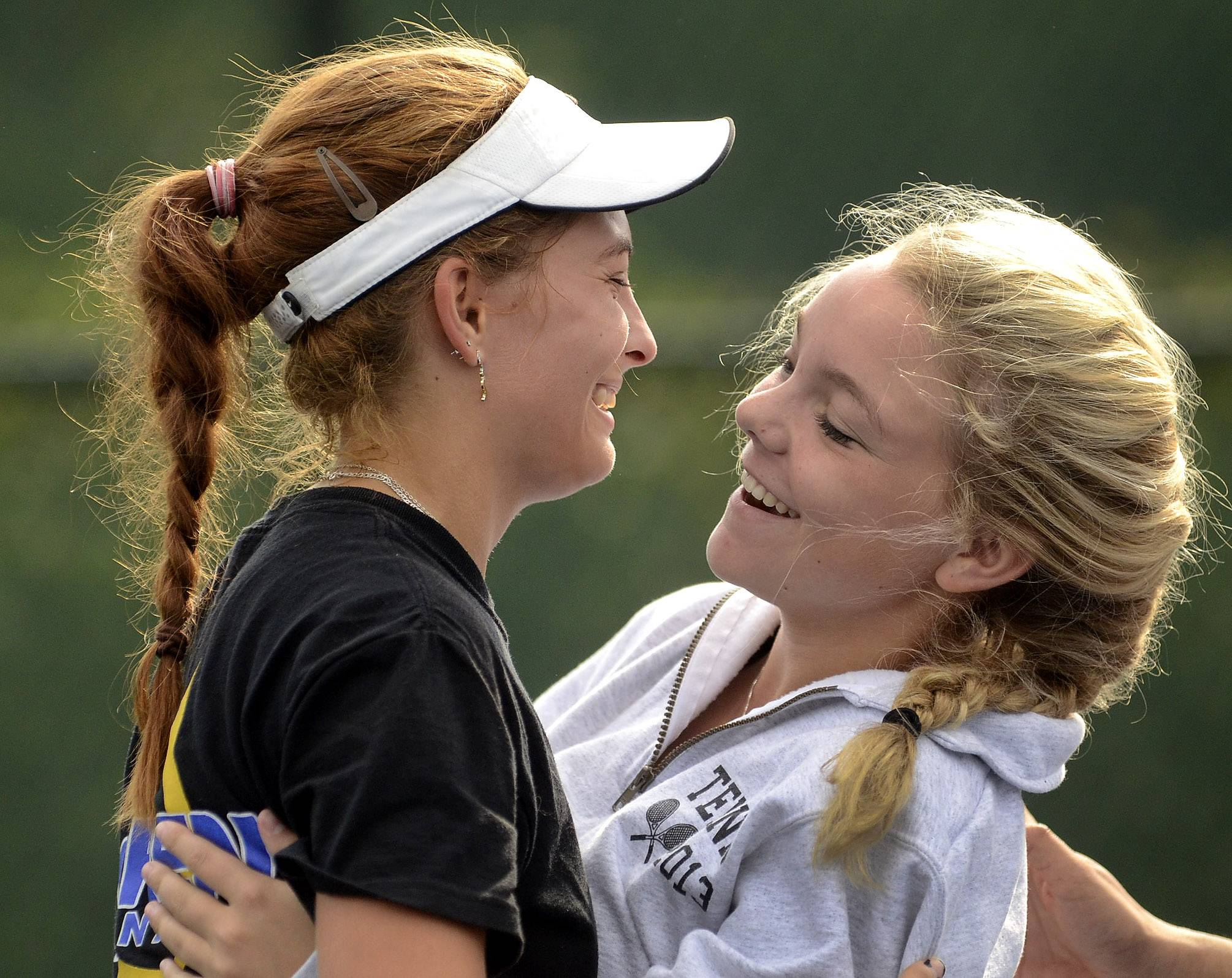 Karyna Bihel of Warren, left, is congratulated by Halle Roach of Libertyville, after finishing second to Lake Forest's Elizabeth Zordani during the North Suburban Conference girls tennis meet last season. Bihel and Roach figure to play key roles for their teams again this fall.