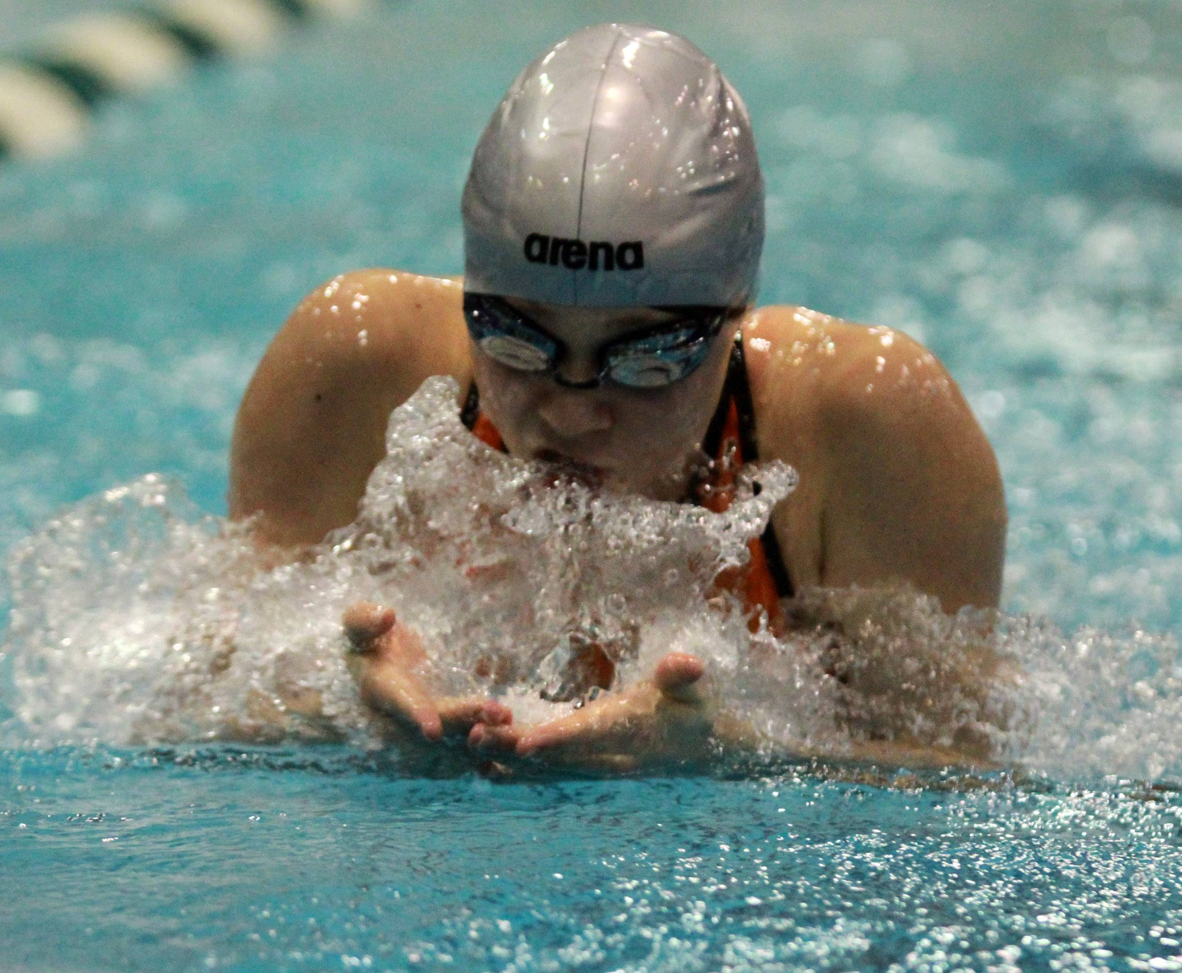 Libertyville's Macey Neubauer swims the breaststroke leg of the 200 medley relay during the girls swimming state finals last fall at New Trier. The quartet placed ninth, and Neuebauer is back for the Wildcats and coach Erik Rogers this fall.