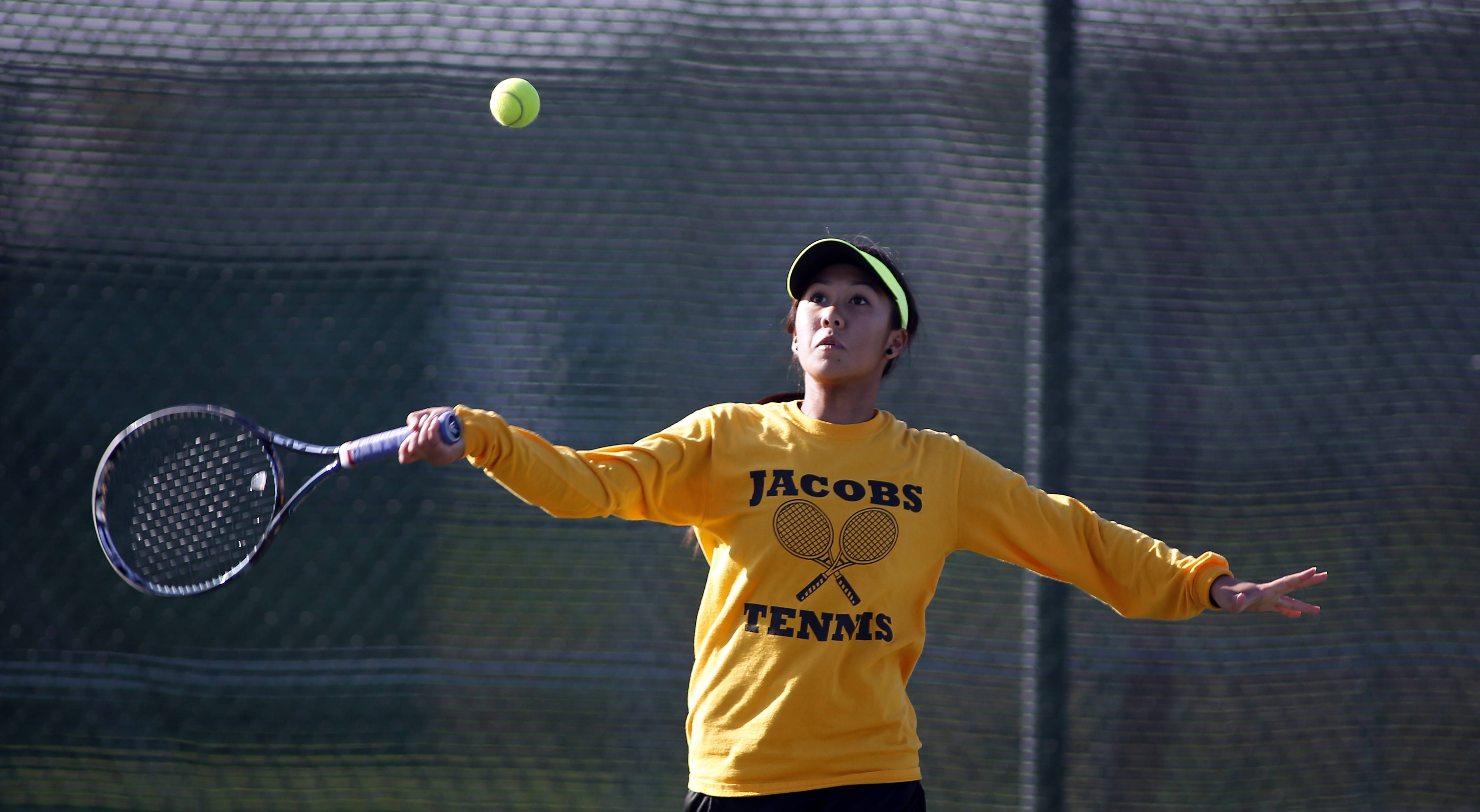 Jacobs' Ashley Kosy returns a volley during the Huntley girls tennis sectional last season.