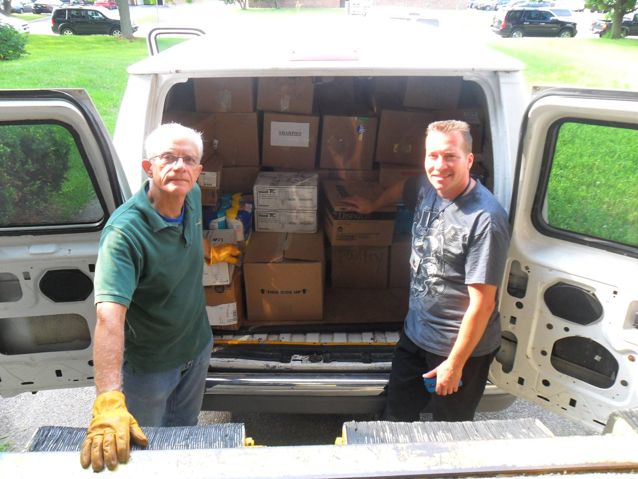 Bill Fehling, left, and Jeff Marker,right, HSP volunteers, with one of the van loads of school suppliesHumanitarian Service Project