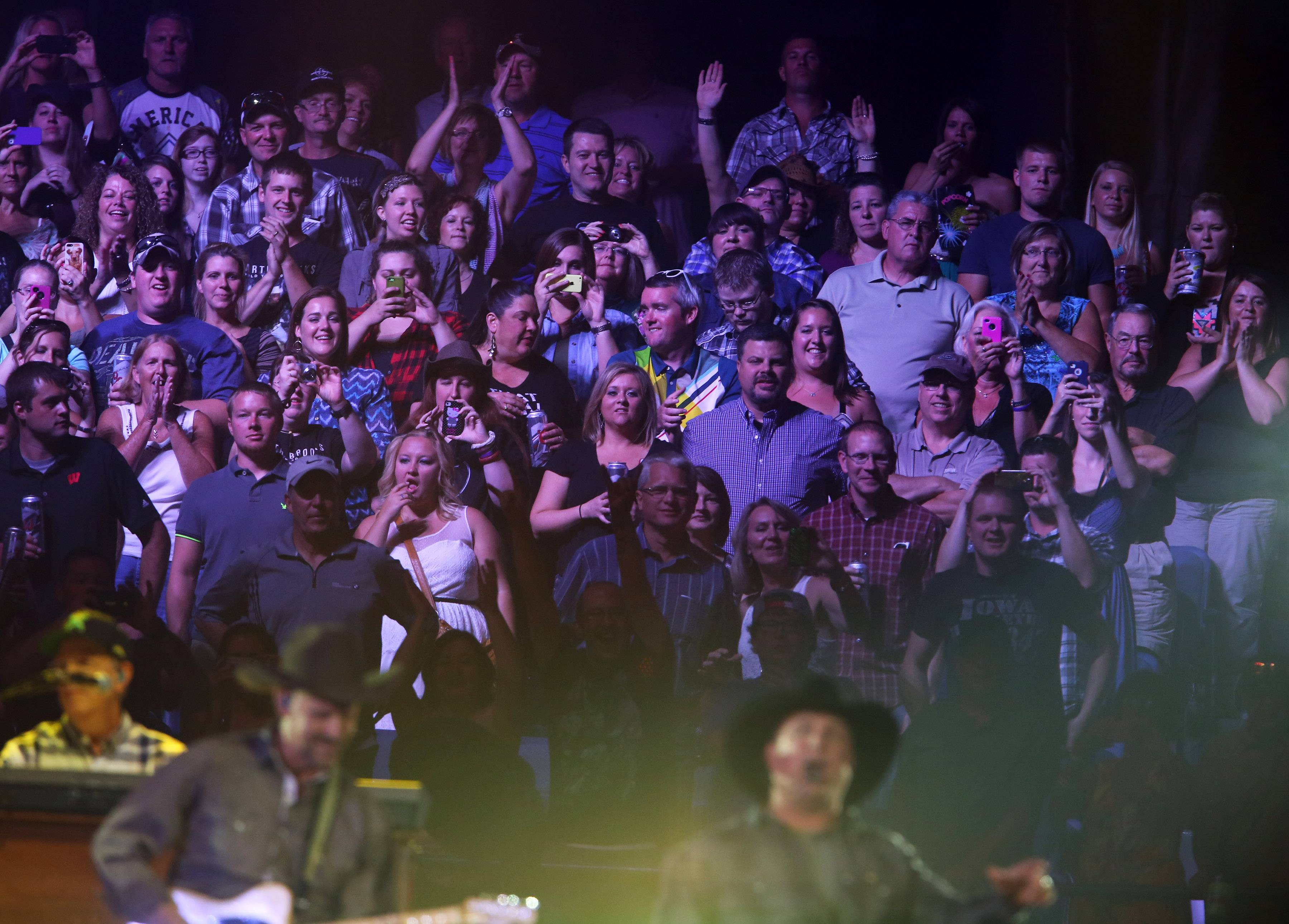 Fans cheer on country music star Garth Brooks as he performs at Allstate Arena on Thursday in Rosemont.