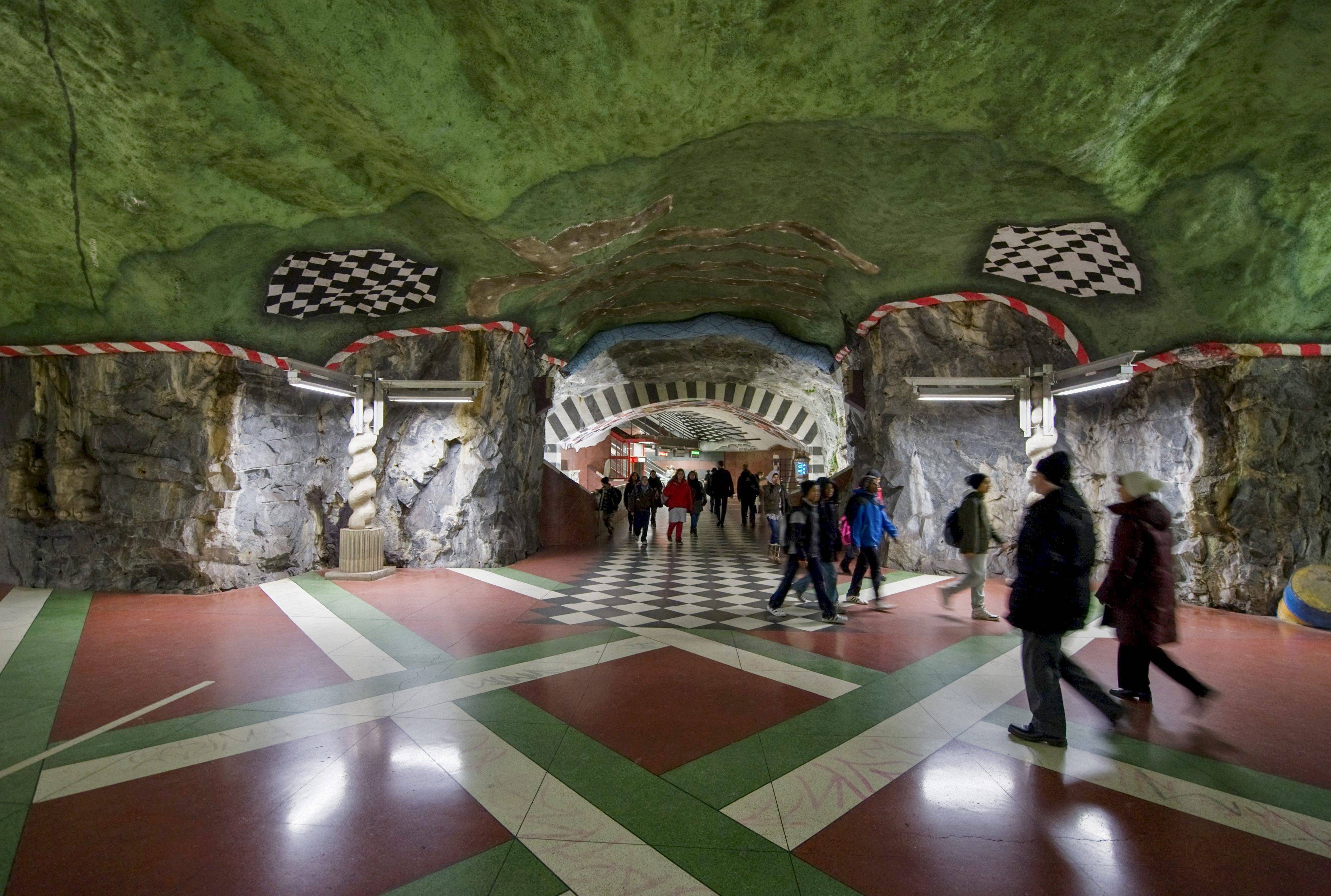 The Kungstradgarden subway station is decorated with murals, mosaics, sculptures or art in Stockholm.