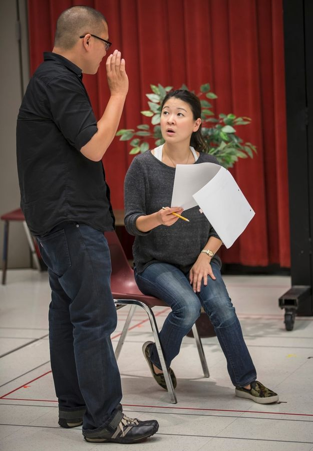 "Jennifer Lim and director Eric Ting rehearse for Goodman Theatre's world premiere of Francis Ya-Chu Cowhig's ""The World of Extreme Happiness,"" in a co-production with the Manhattan Theatre Club."
