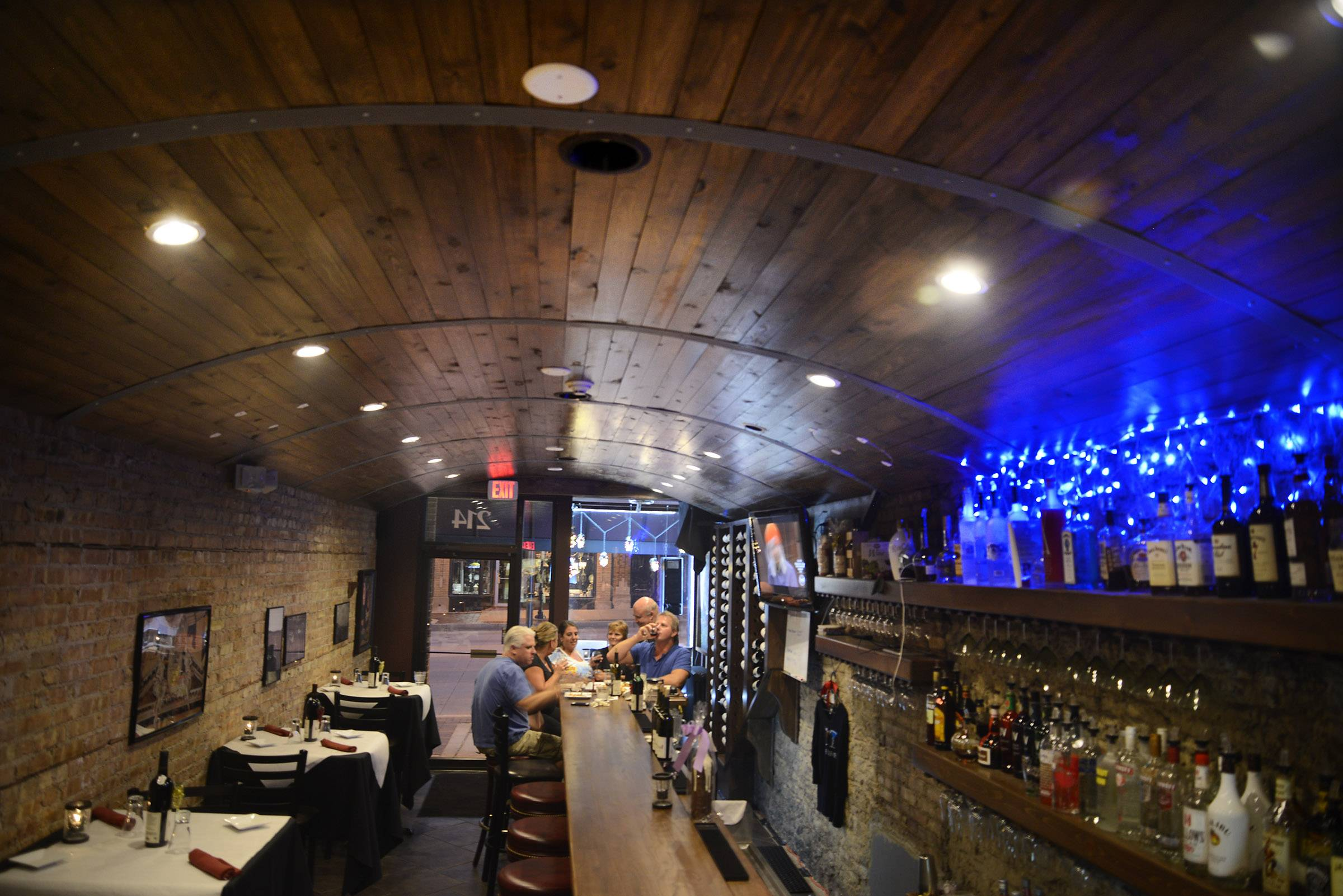 Acquaviva Tasting and Wine Bar opened in St. Charles last year. The curved wooden plank ceiling mimics a wine barrel.