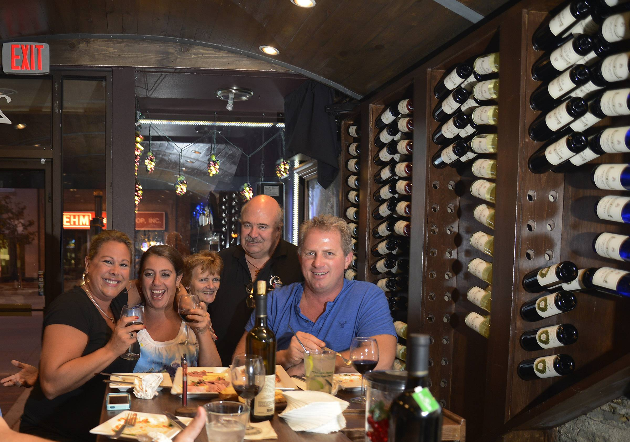 Friends gather for wine and more at Acquaviva Tasting and Wine Bar in St. Charles.