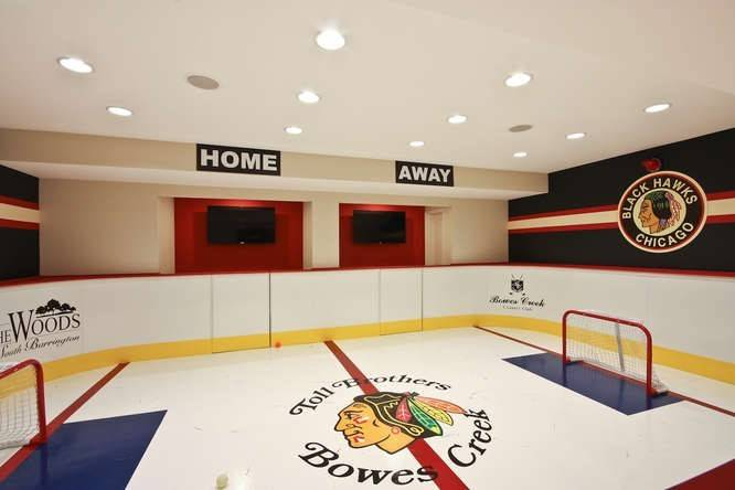 The basement hockey rink in the Parker model home at Bowes Creek is a hit with prospective buyers who tour the community.