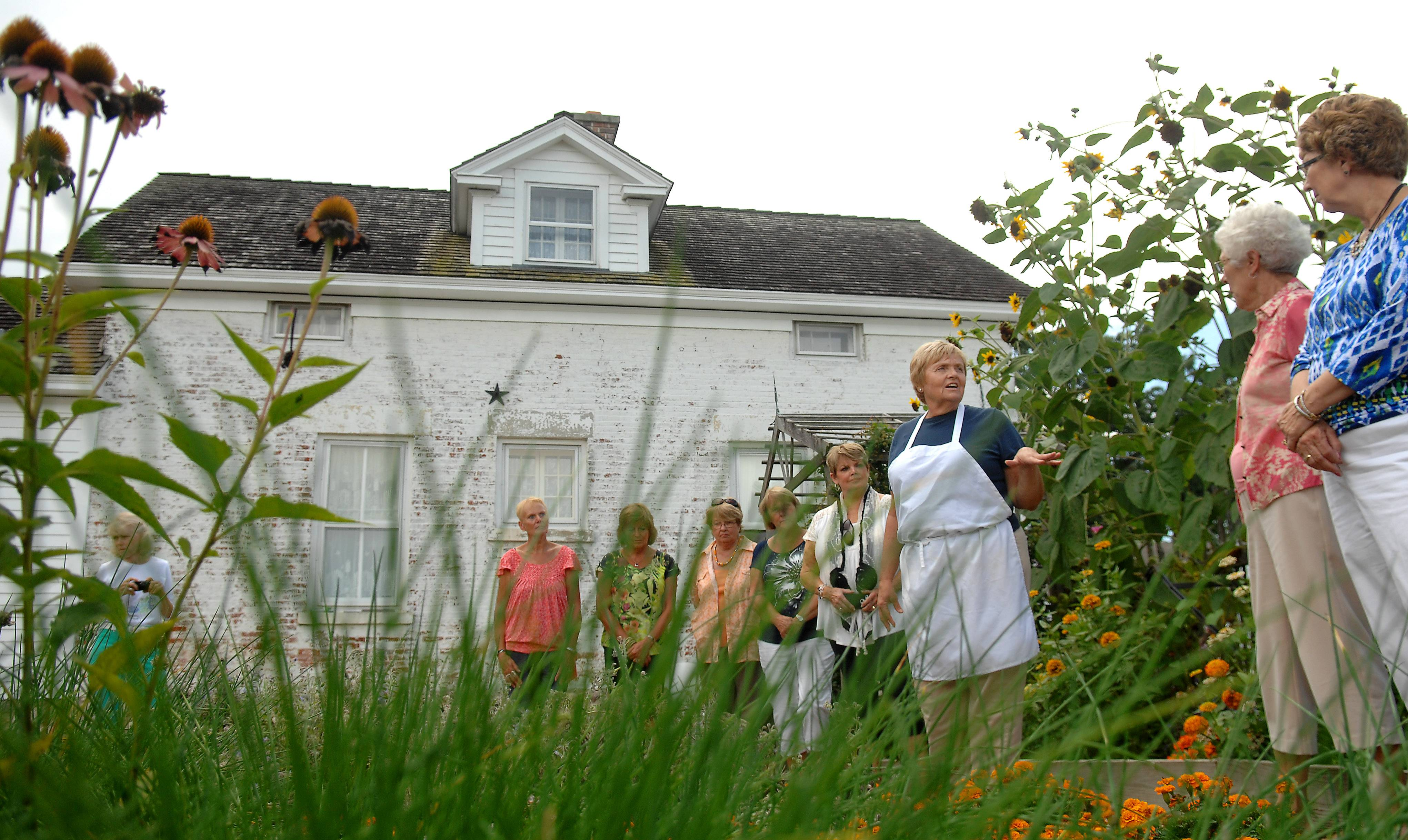 Penny Newkirk takes her students on a tour of her herb garden, which is just outside the 1800s-era building where she runs Country Garden Cuisine in Campton Hills. She teaches how food starts in her garden ends up on a plate using techniques that can easily be done at home.