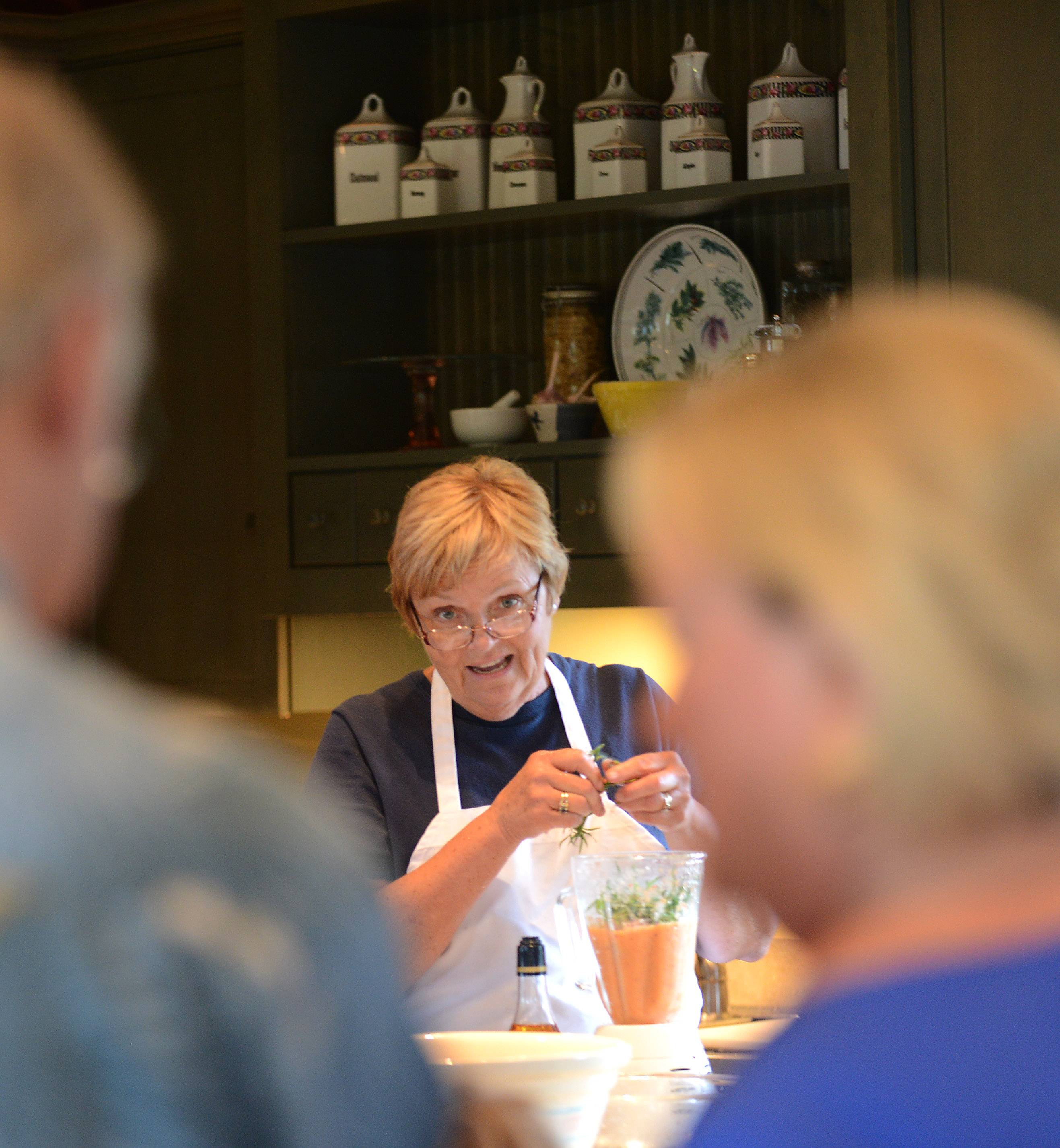 "Penny Newkirk of Campton Hills makes a sauce during a ""lunch and learn"" class at Country Garden Cuisine."