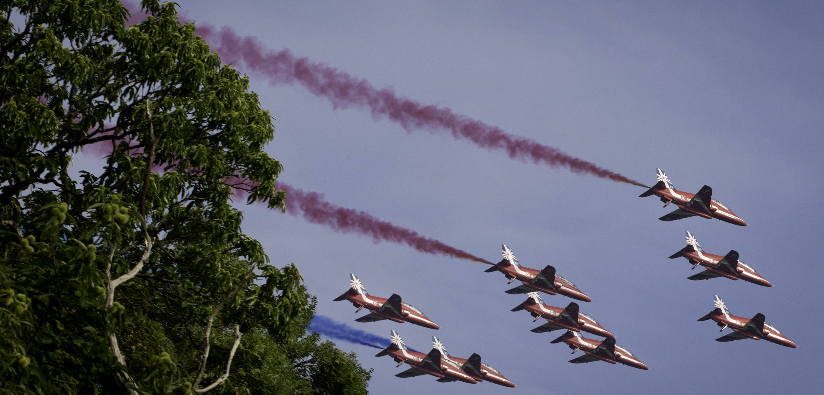 Military jets perform a flyover during a NATO summit at the Celtic Manor Resort in Newport, Wales on Friday, Sept. 5, 2014.