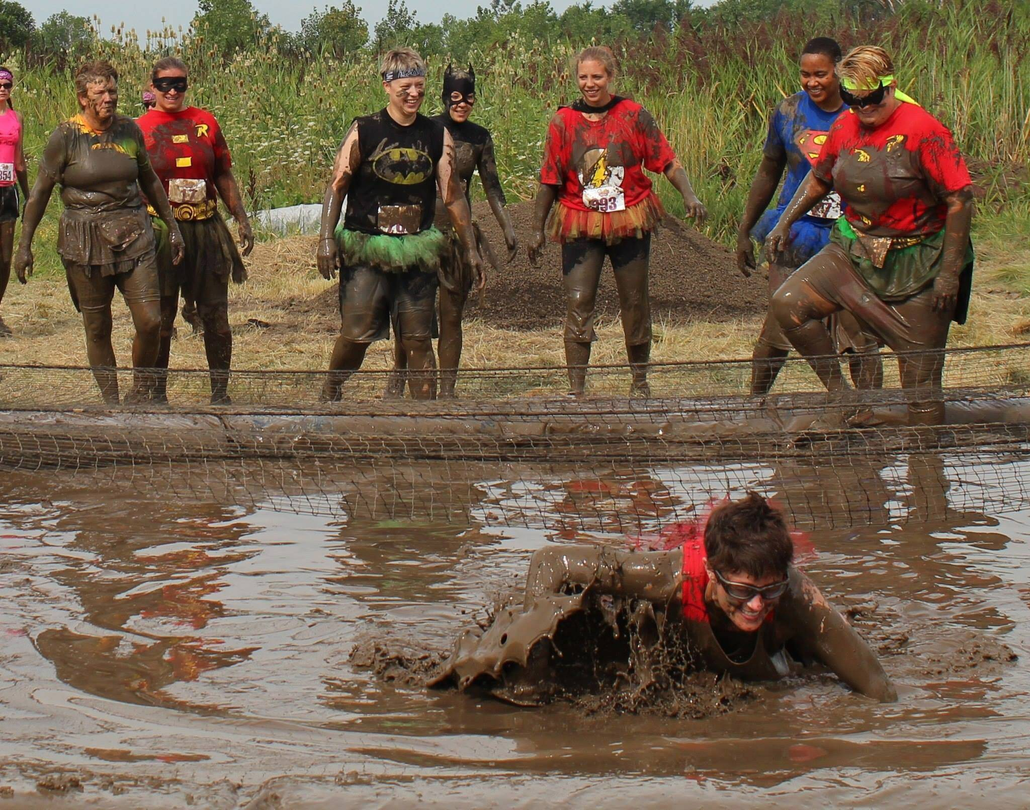 A group of women dressed as comic book heroes as they participated in the 5K mud run at Komen Pretty Muddy 2014 in Orland Park.