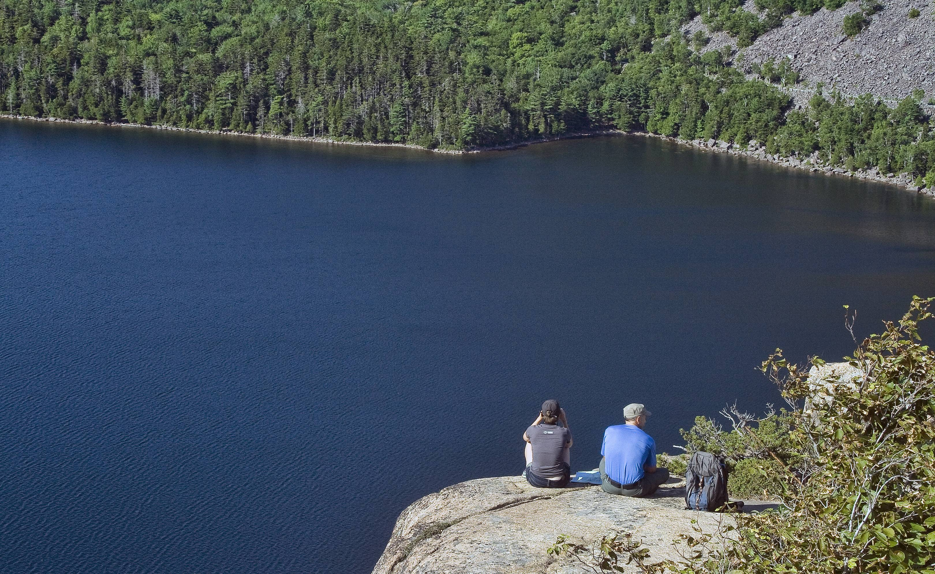 My husband and daughter enjoy the view by sitting together after hiking Bubble Rock in Acadia National Park, Maine. No words necessary, as both enjoy each other's company and the beauty of our National Parks. This was taken with a Canon Rebel XTI, 18-55 mm lens.