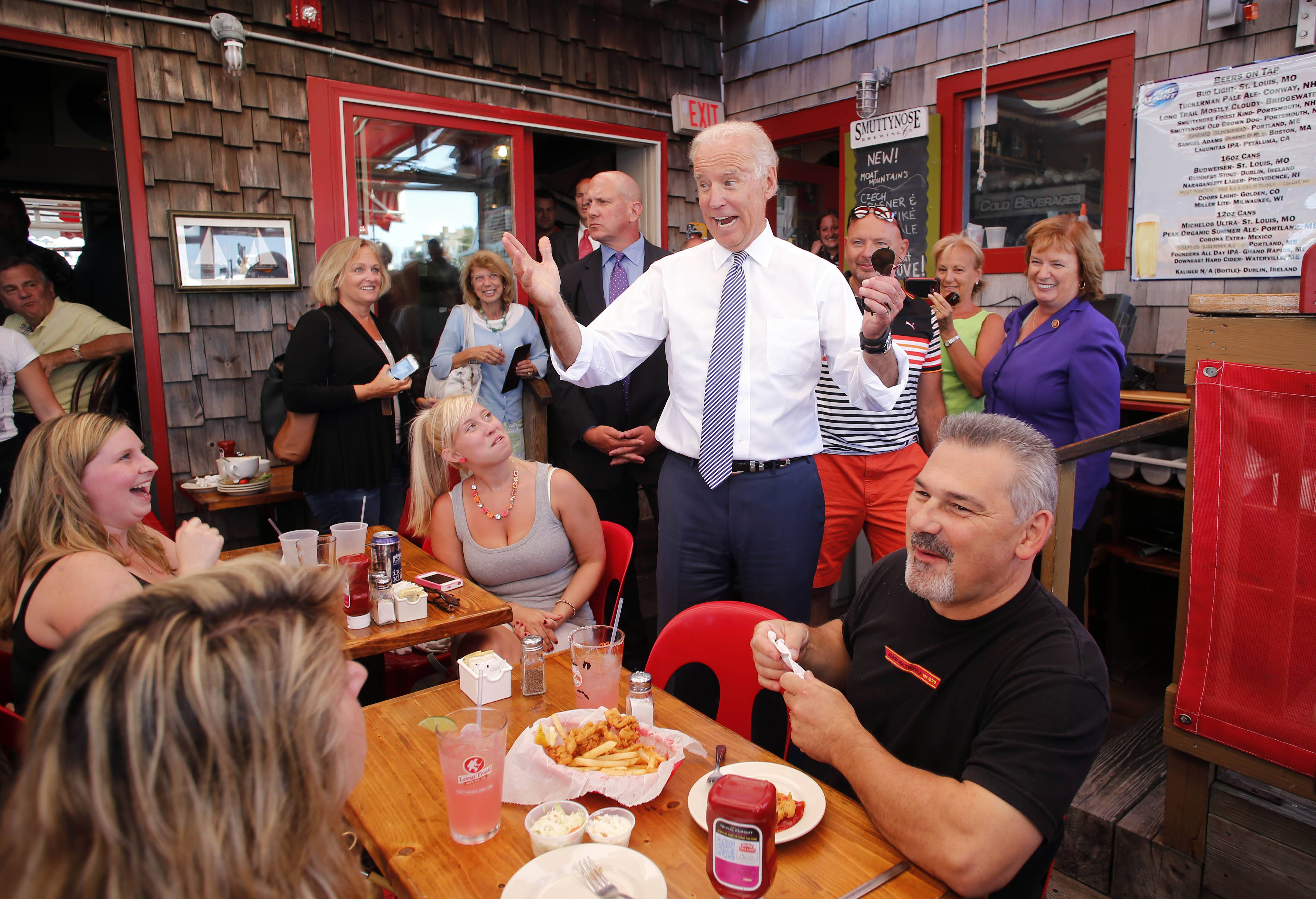 Vice President Joe Biden greets patrons at the Old Ferry Landing restaurant Wednesday while making a stop for lunch in Portsmouth, N.H.