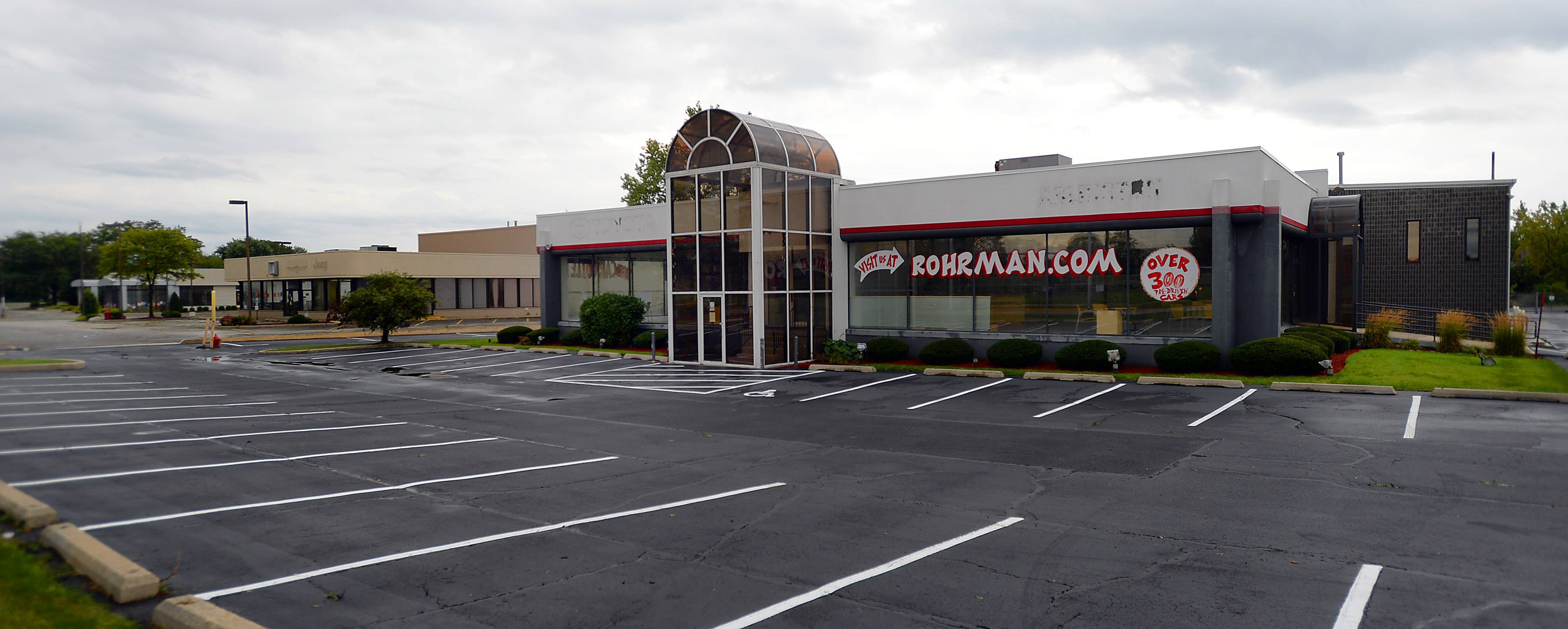 Bob Rohrman is eyeing the former Arlington Toyota property for a used car dealership.