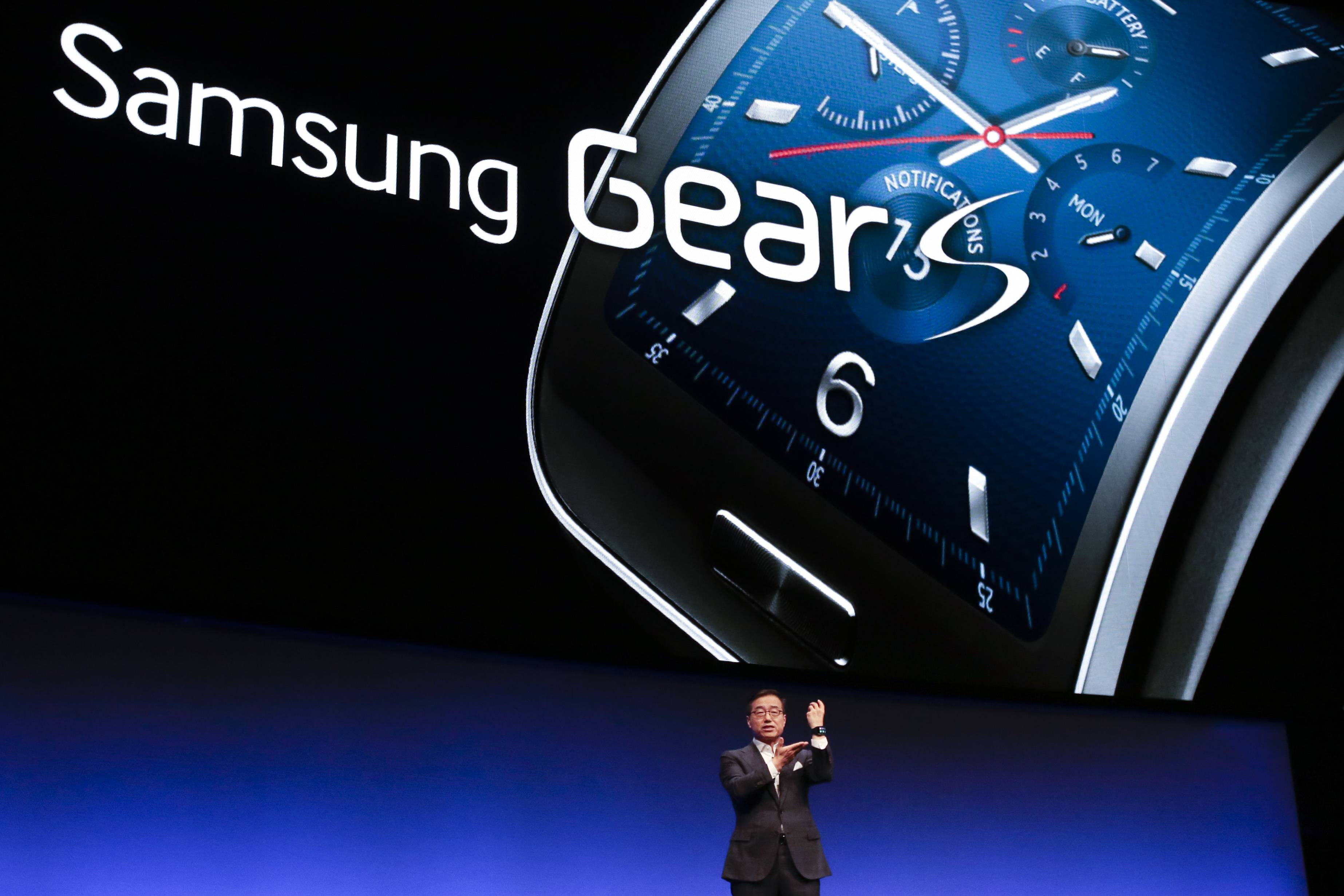 DJ Lee, Executive Vice President of Samsung, presents a Samsung Gear S smartwatch Wednesday during his keynote speech at an unpacked event of Samsung ahead of the consumer electronic fair IFA in Berlin.