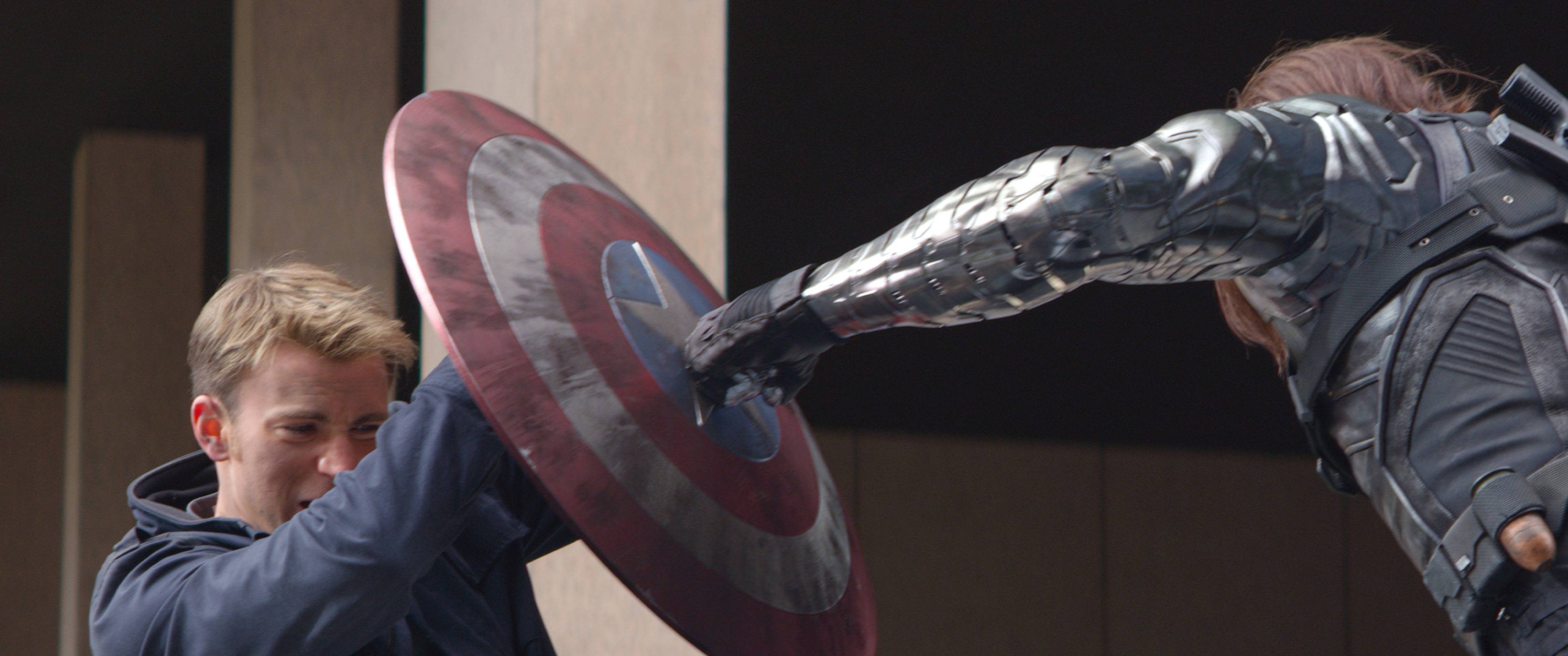 "Steve Rogers (Chris Evans), left, battles an assassin (Sebastian Stan) in ""Captain America: The Winter Soldier."""