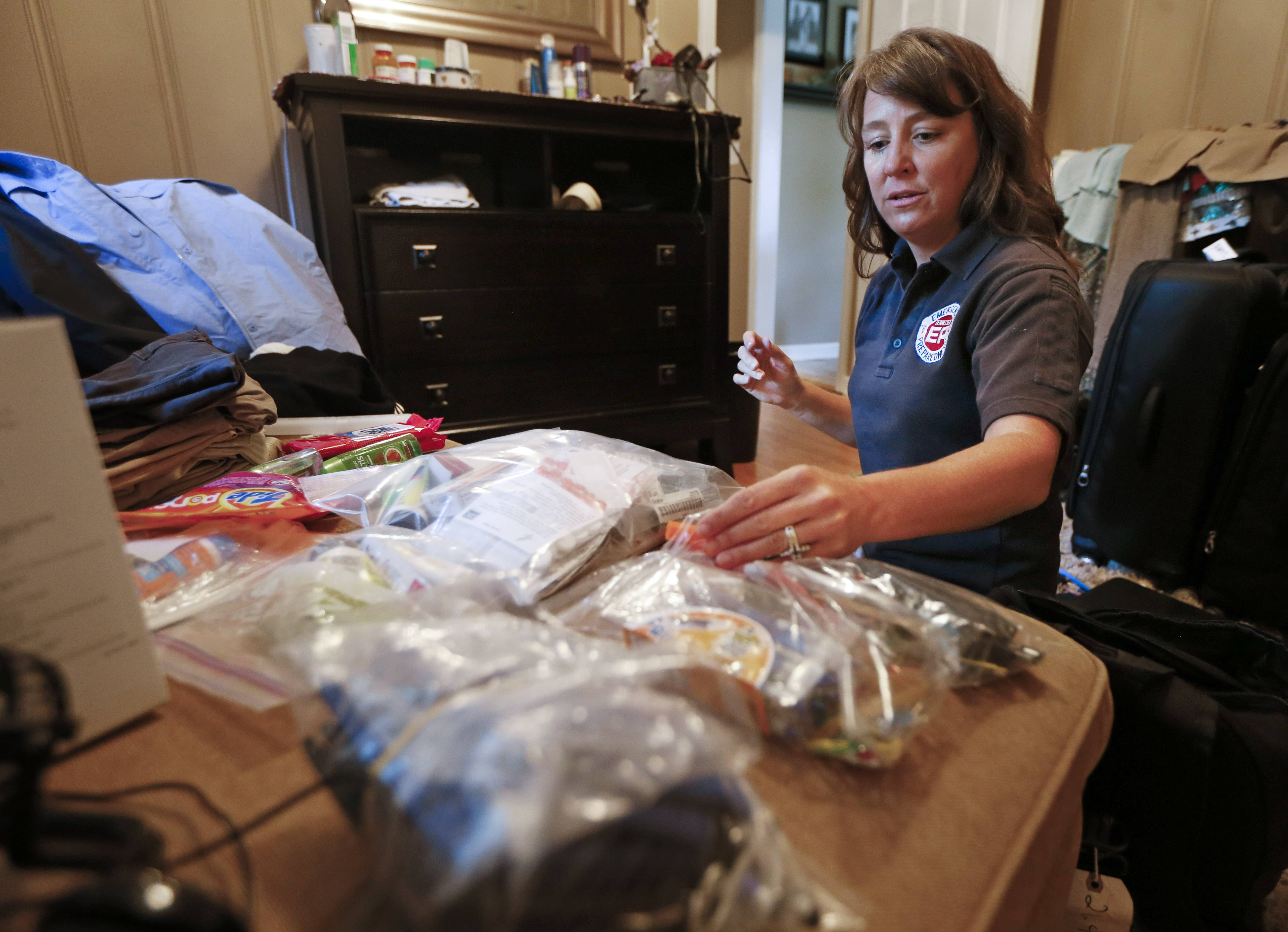 Rendi Murphree, an epidemiologist with the Centers for Disease Control and Prevention who will soon be leaving for Monrovia, Liberia, packs Friday for her trip at her home in Nashville, Tenn.