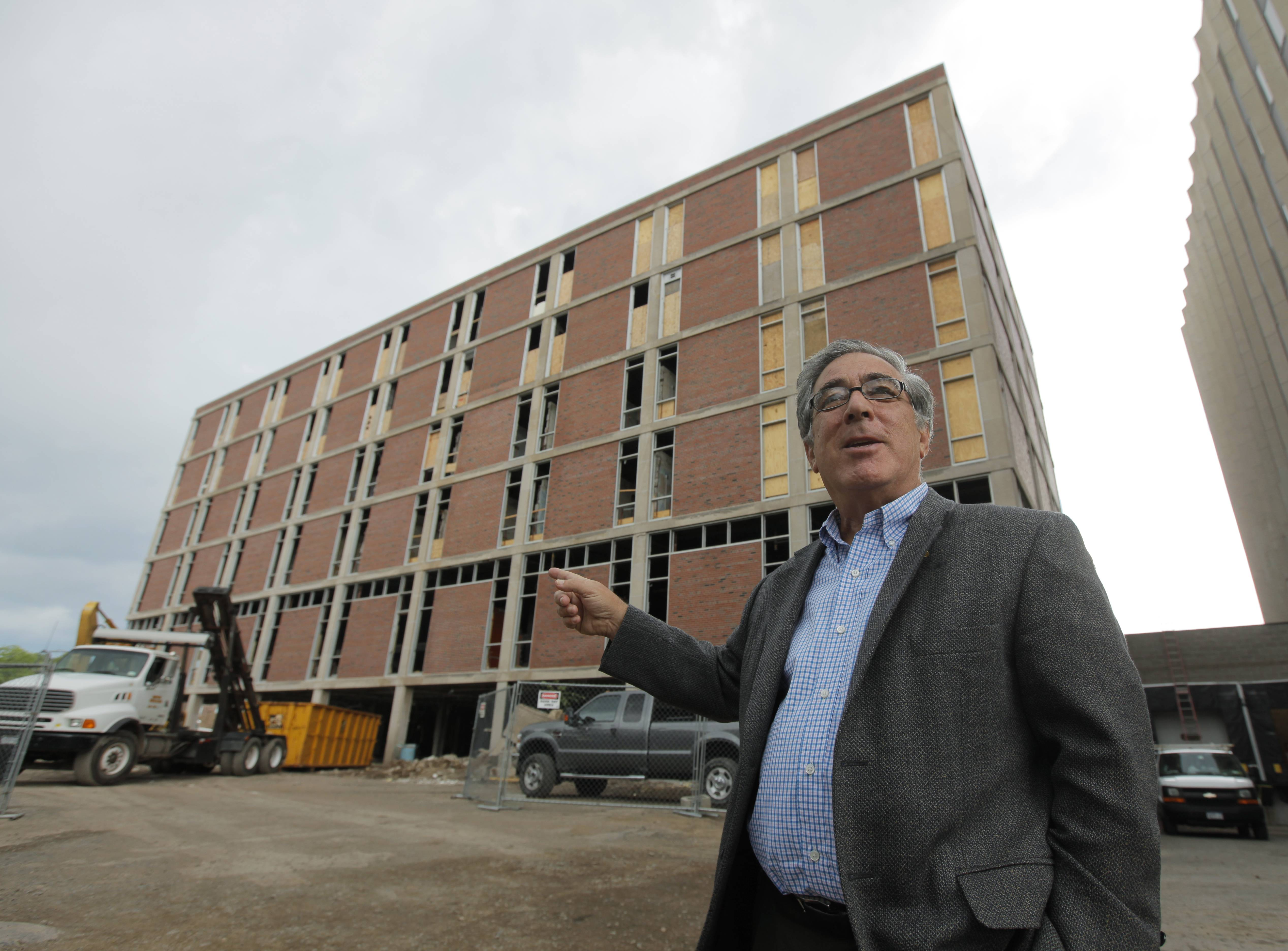 Larry Glazer gestures toward a building to be demolished on Alexander Street in Rochester, N.Y. Glazer and wife, Jane, were aboard their small plane, which took off from the Greater Rochester International Airport, as it flew 1,700 miles down the East Coast on Friday before finally crashing off the coast of Jamaica.