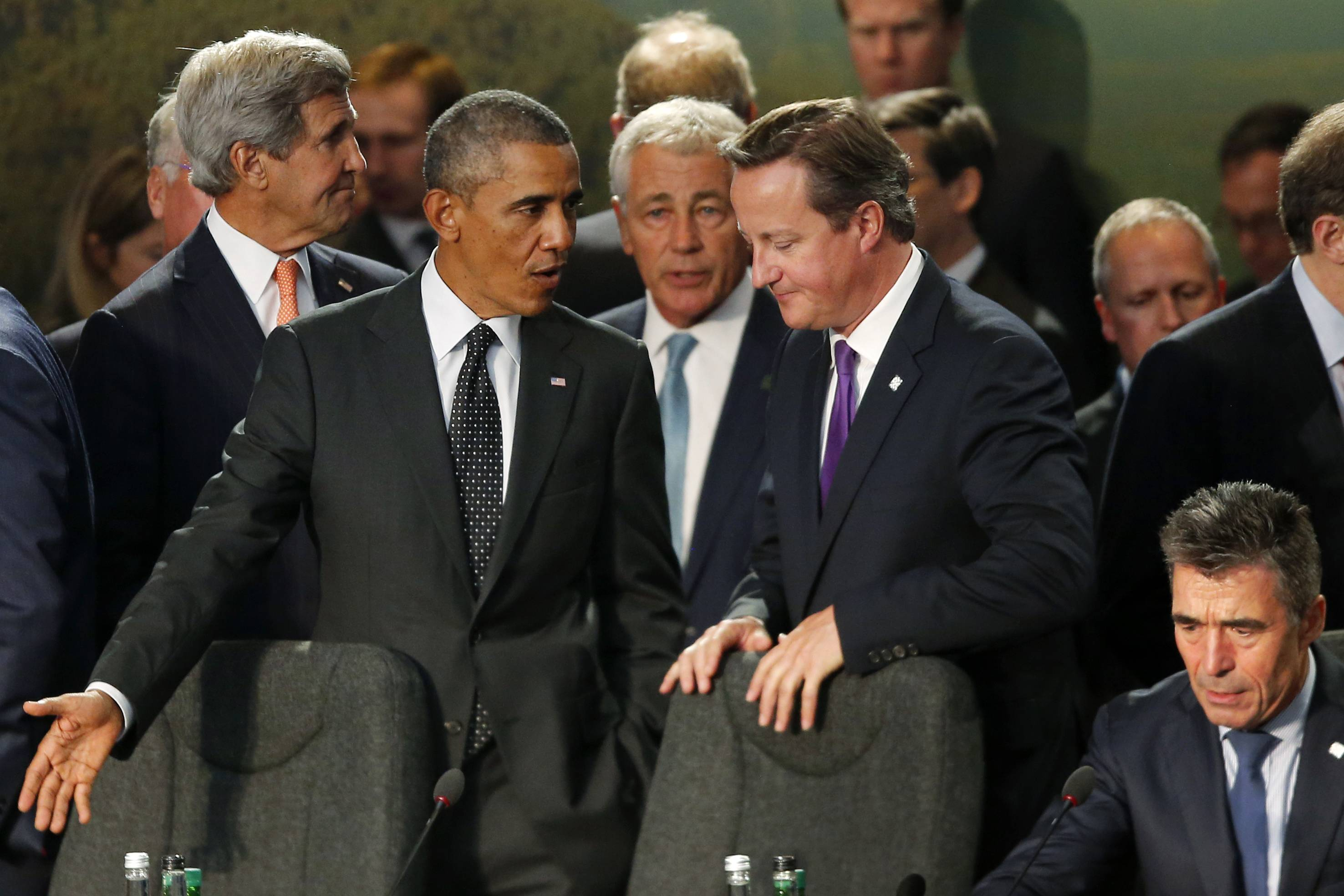 President Barack Obama speaks Thursday with British Prime Minister David Cameron as NATO leaders meet regarding Afghanistan at the NATO summit at Celtic Manor in Newport, Wale From left are, Secretary of State John Kerry, the president, Defense Secretary Chuck Hagel and NATO Secretary-General Anders Fogh Rasmussen.