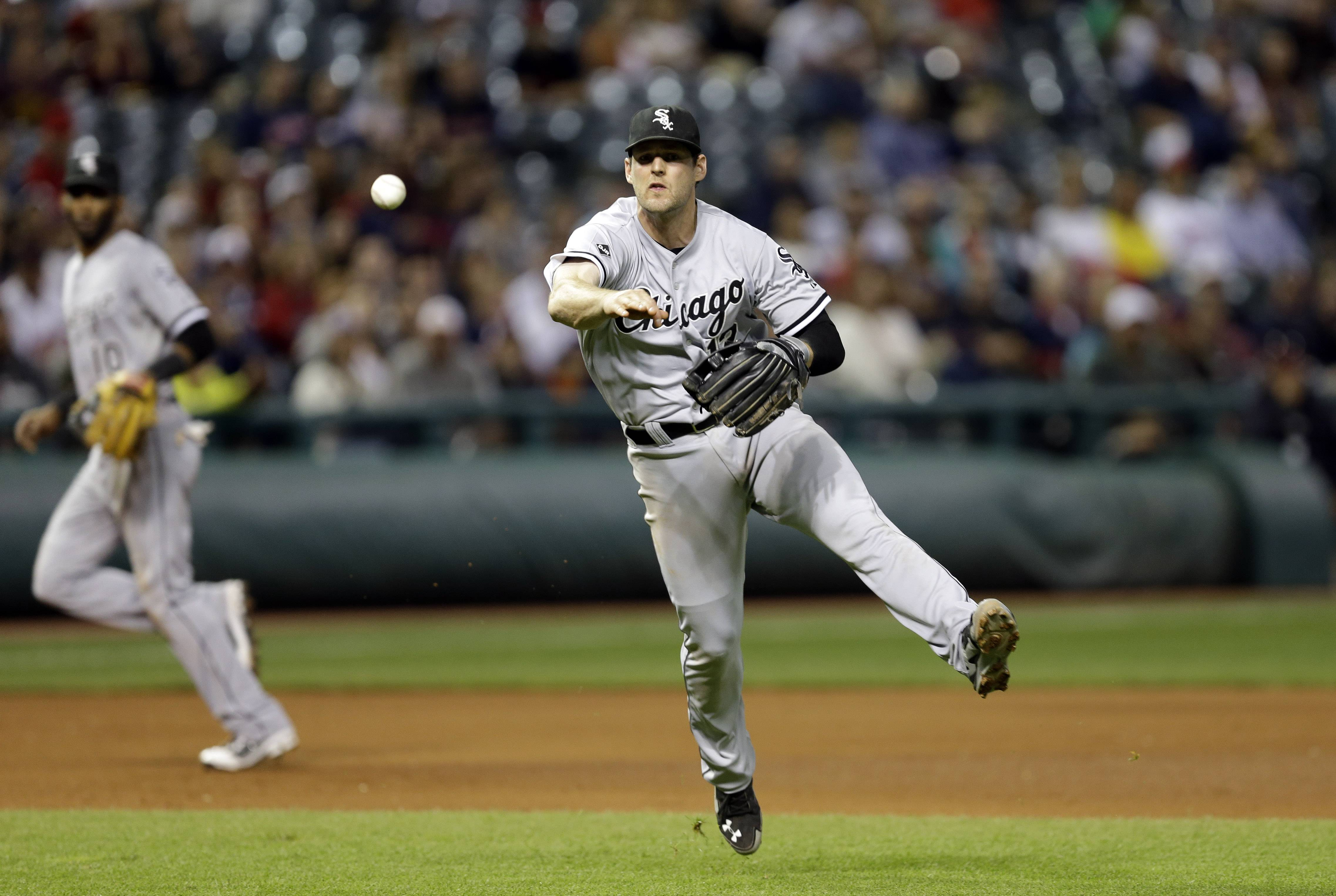 Chicago White Sox third baseman Conor Gillaspie throws to first on a ground ball by Cleveland Indians' Jose Ramirez in the fifth inning of a baseball game Saturday, Sept. 6, 2014, in Cleveland. Ramirez was called safe which was upheld on replay review.