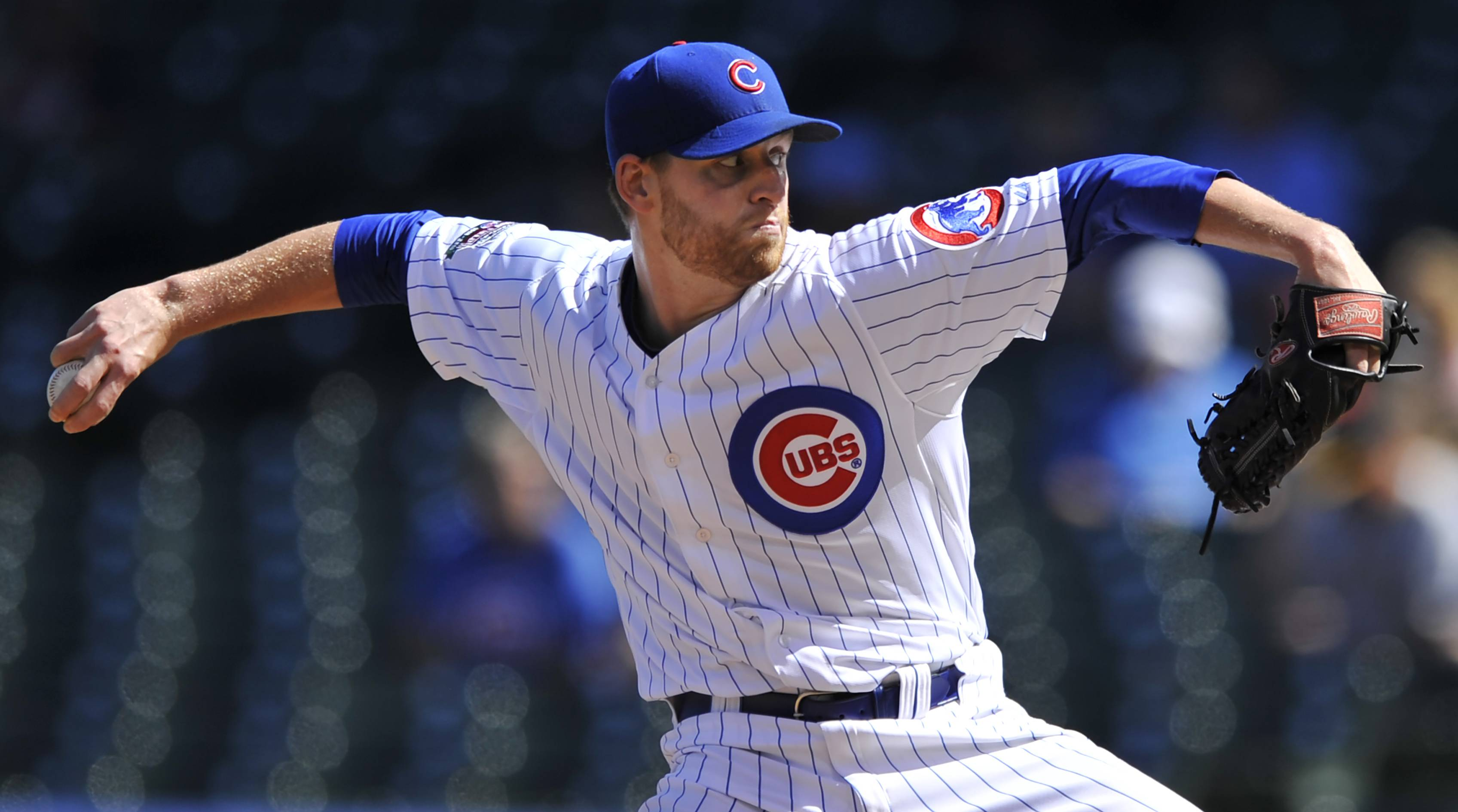 Chicago Cubs relief pitcher Neil Ramirez delivers during the seventh inning of a baseball game against the Pittsburgh Pirates continued from Friday's rain delay in Chicago, Saturday, Sept. 6, 2014. (AP Photo/Paul Beaty)