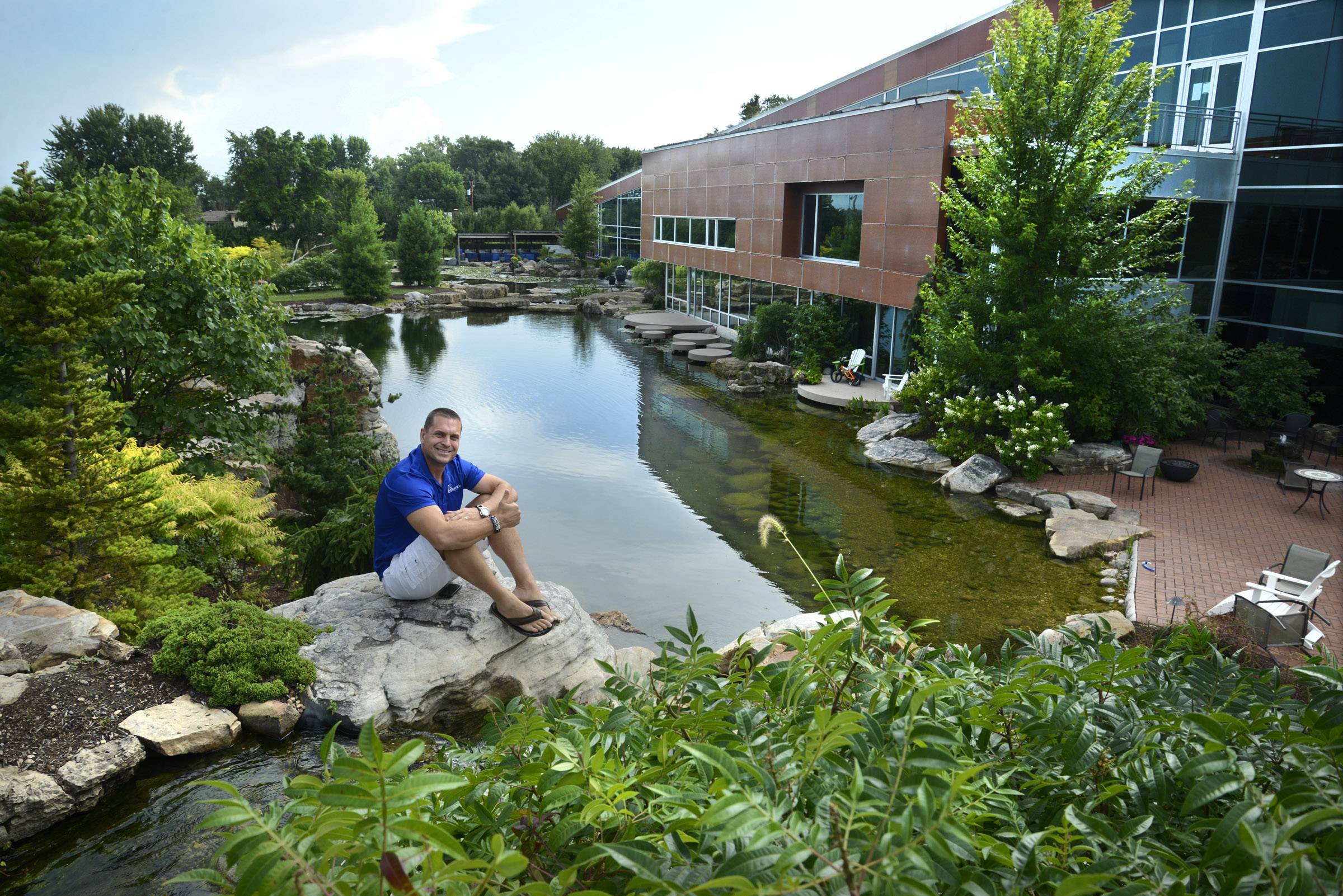 Marvelous Greg Wittstock, Chief Executive Officer Of Aquascape Inc., Shows Part Of  The Pond