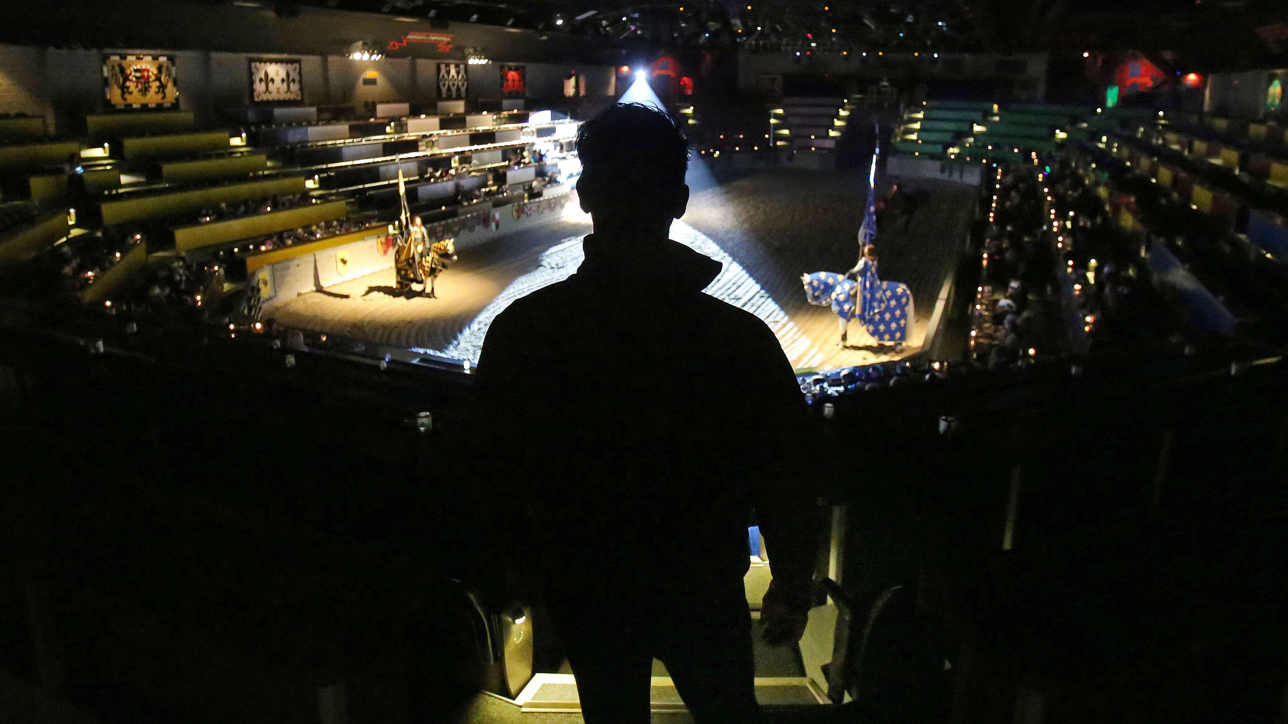 While doing a story on Medieval Times horse trainer Mario Contreras, I made this picture of him looking over one of the shows. I like the way the spotlight frames his body as he watches from the stands. This photo was originally published in the Perspective column in the print edition of the Daily Herald.