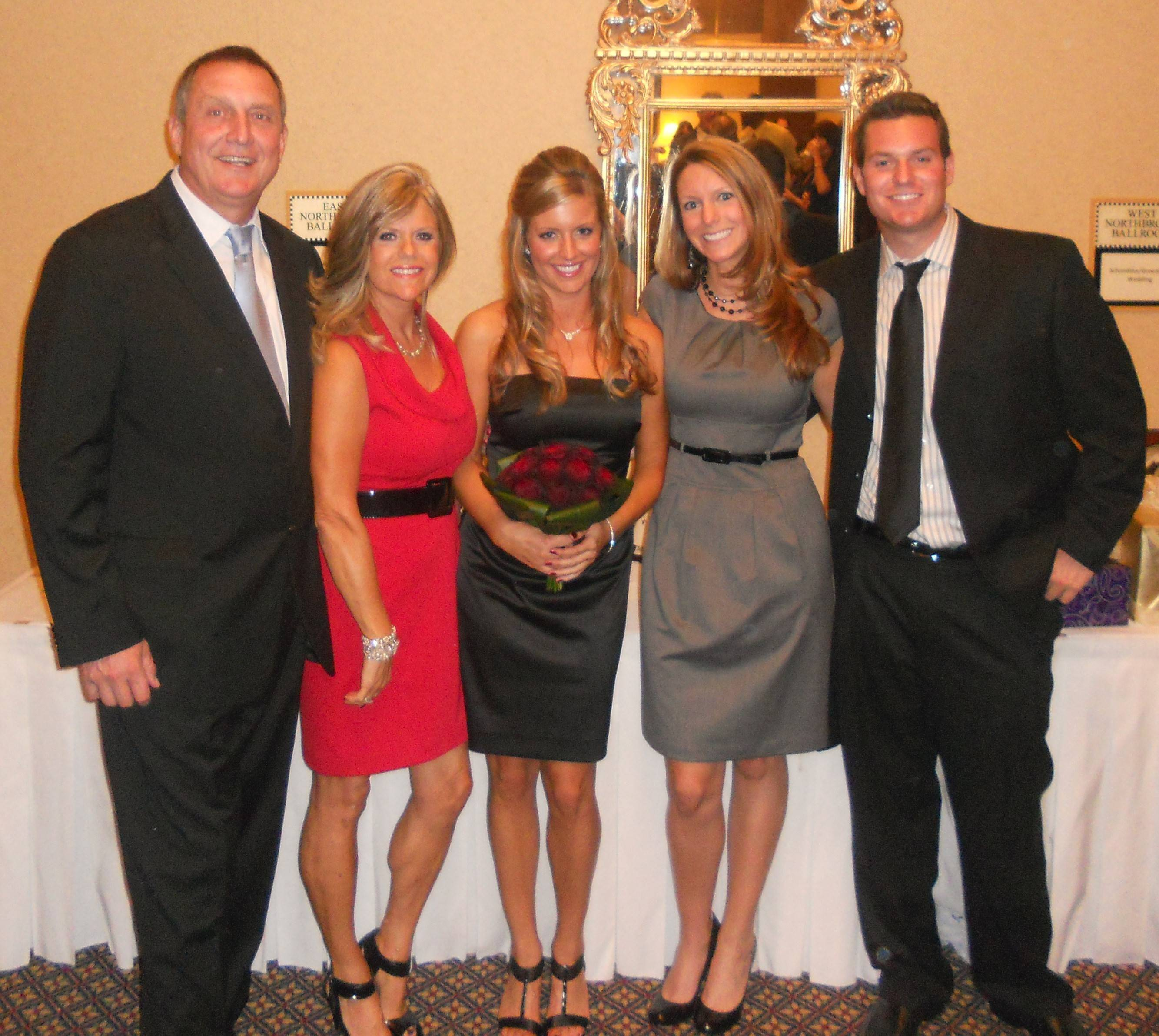 Ryan Flannigan, far right, with his parents, Timothy and Debra, and sisters Courtney and Carly