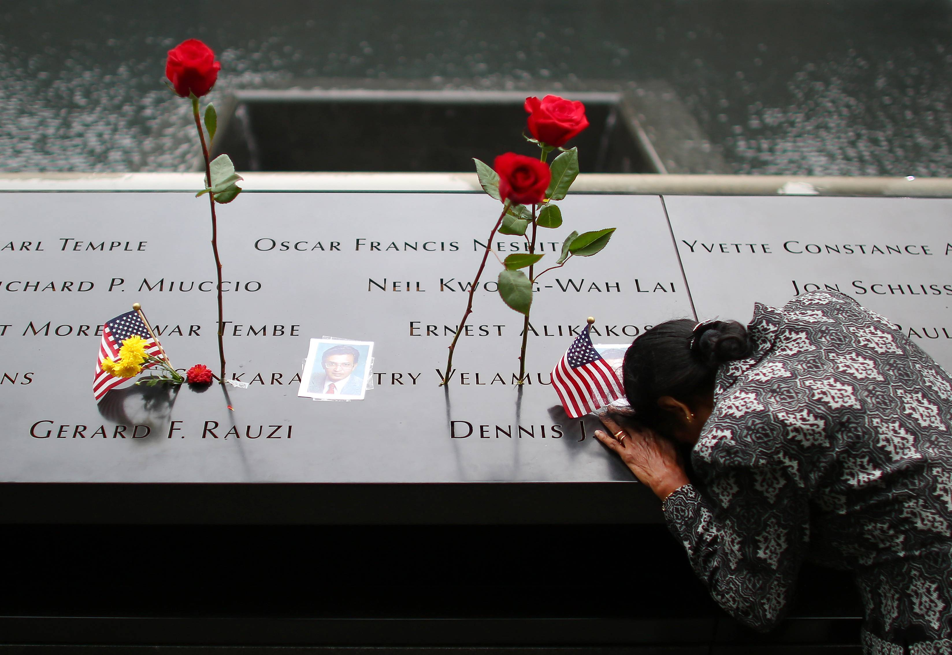 New terror fight casts shadow over 9/11 ceremonies