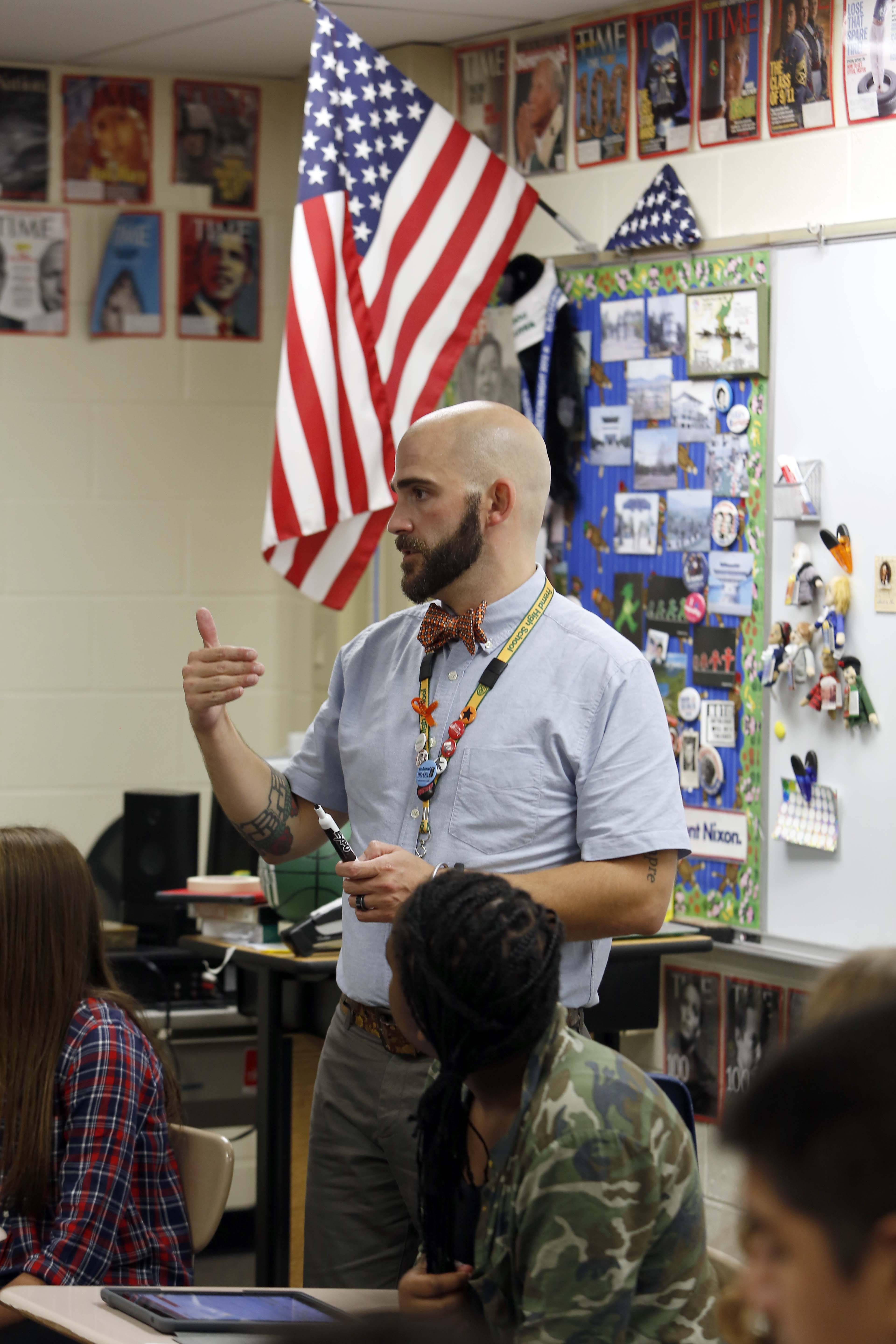 Fremd High School social studies teacher Jason Spoor-Harvey talks to his students Wednesday to help start a discussion on the long-term impacts of the Sept. 11, 2001, terrorist attacks.