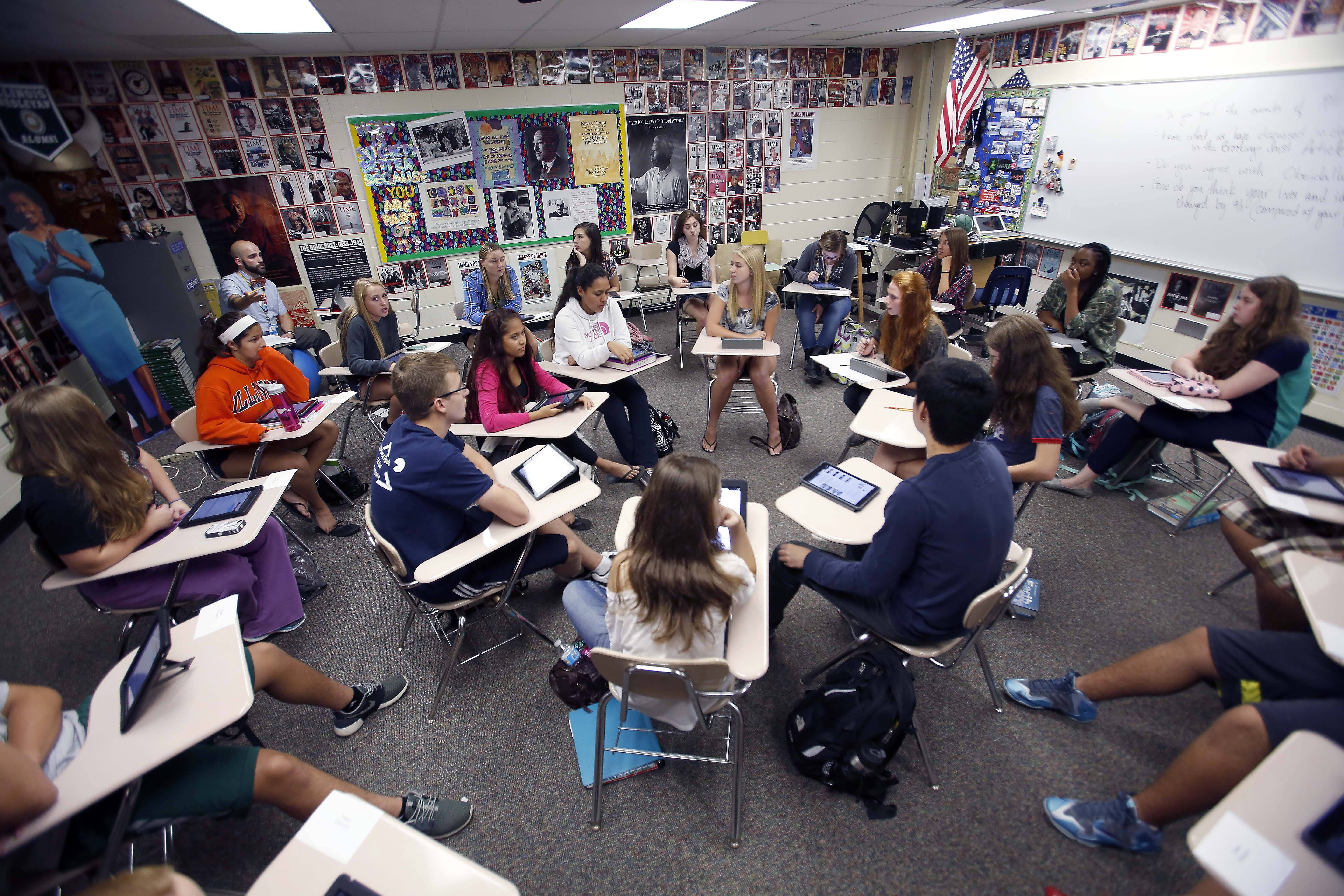 Students in a social studies class at Fremd High School in Palatine discuss the long-term impacts of the Sept. 11, 2001, attacks. The students, most 15 and 16 years old, were too young to remember the day of the attacks.