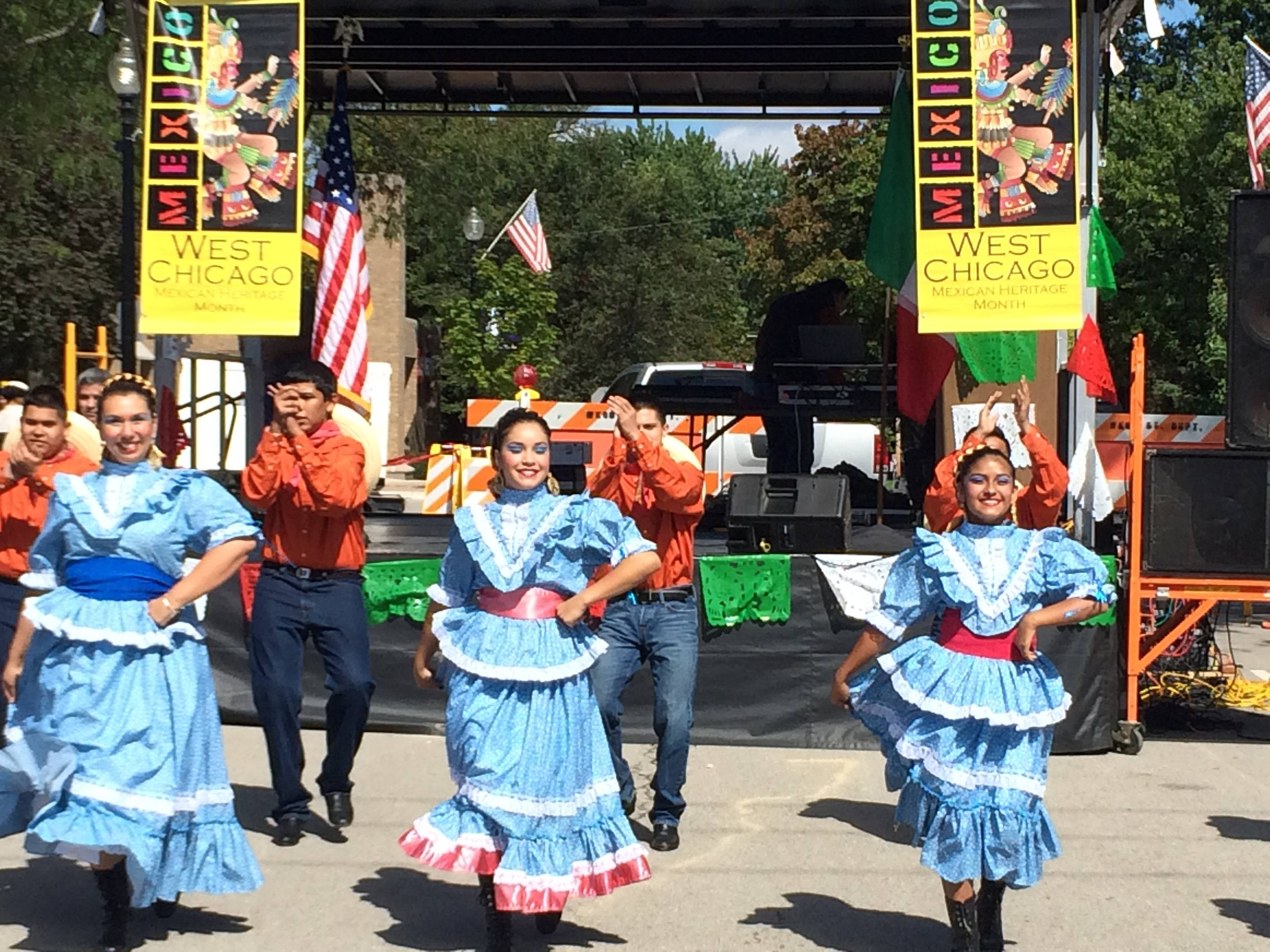 Mexican folklore dance troupe Ballet Folklrico Quetzalcoatl performs Saturday at West Chicago's Mexican Independence day parade and celebration.