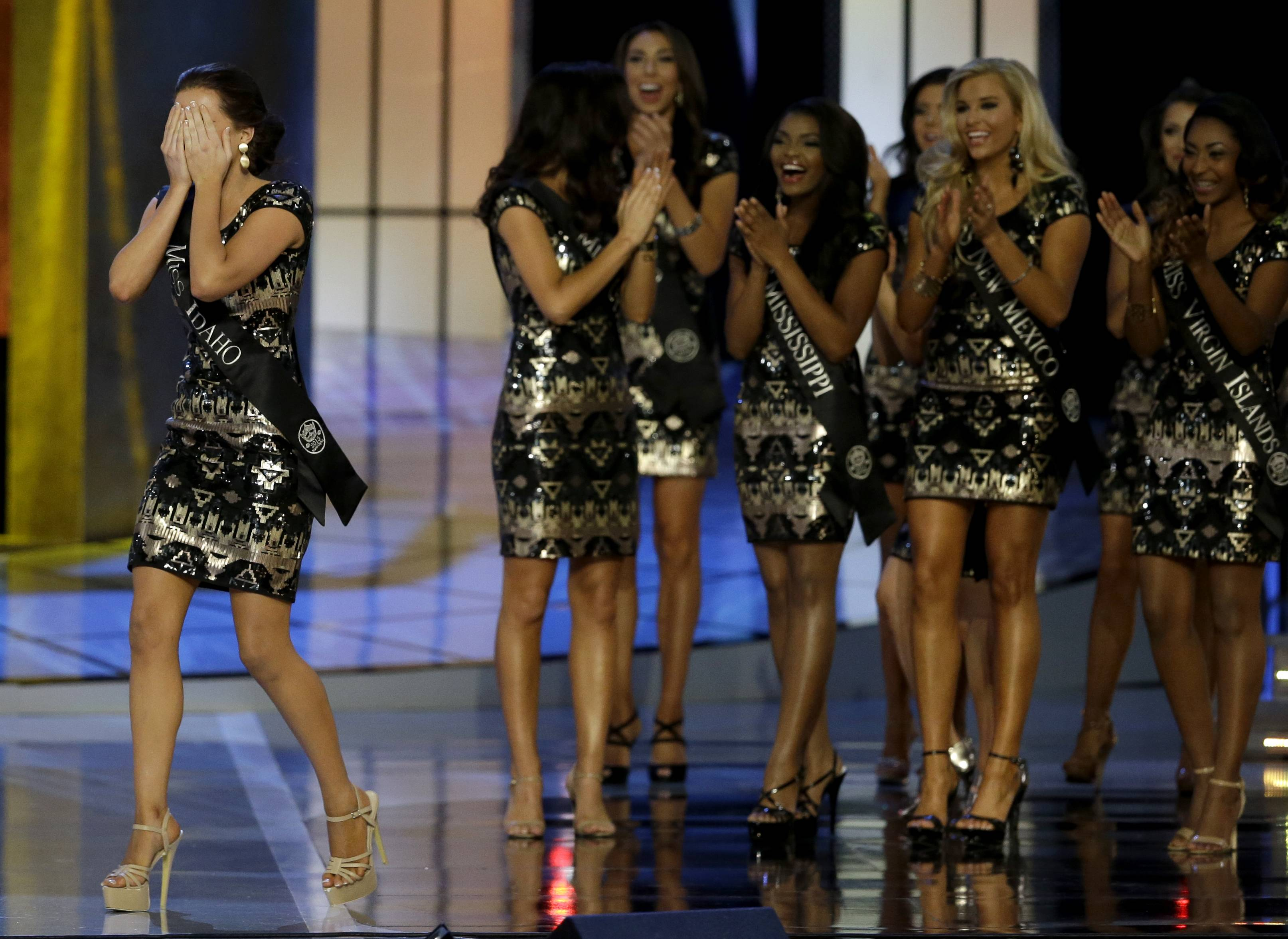 Miss America 2014 Nina Davuluri walks on stage during the Miss America 2015 pageant Sunday in Atlantic City, N.J.