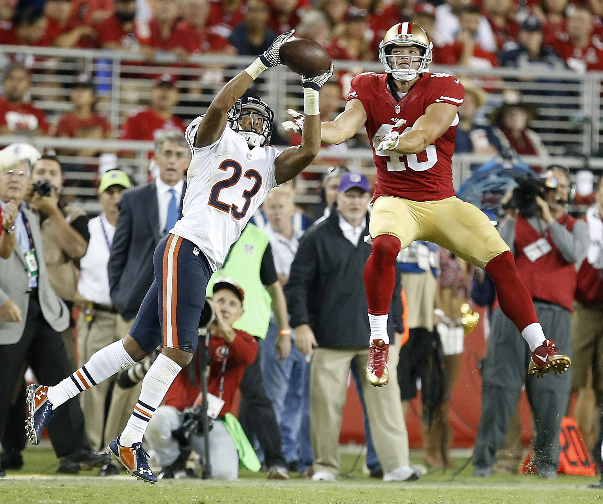 Chicago Bears cornerback Kyle Fuller (23) intercepts a pass intended for San Francisco 49ers tight end Derek Carrier during the fourth quarter of an NFL football game in Santa Clara, Calif., Sunday, Sept. 14, 2014.
