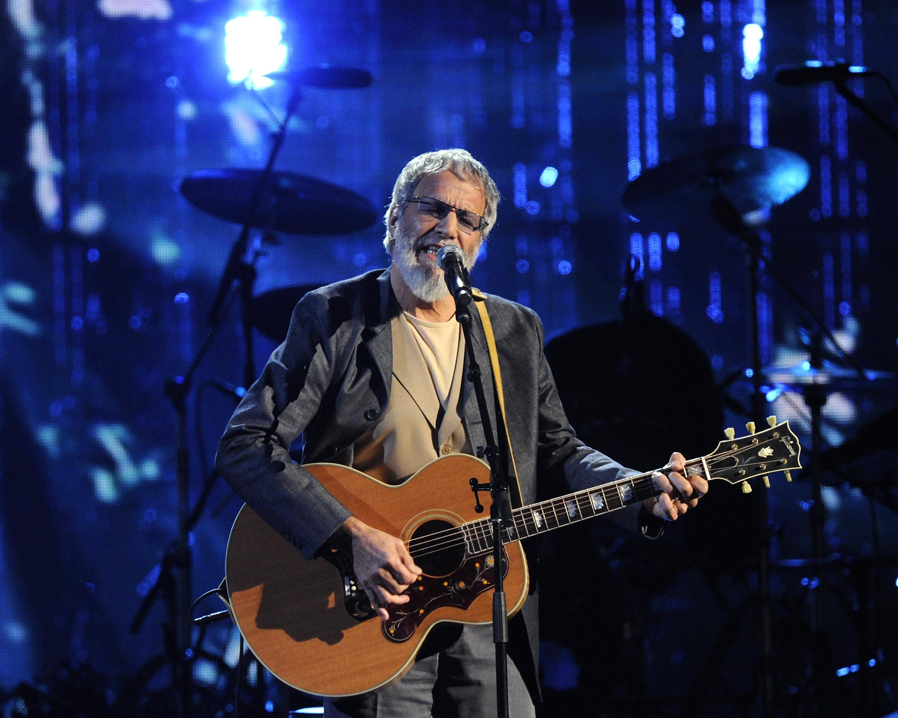 "Hall of Fame Inductee Cat Stevens performs at the 2014 Rock and Roll Hall of Fame Induction Ceremony in New York. Stevens is taking the ""Peace Train"" back on the road. He announced Monday that he will make a brief concert tour in North America this December, including a stop in Chicago on Dec. 9/."