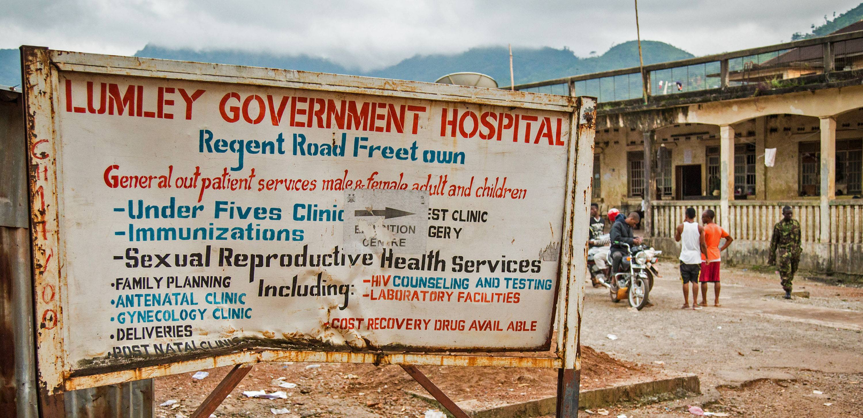 "A sign board showing directions to the Lumley Government Hospital, where medical doctor Olivet Buck worked before contracting the Ebola virus and passing away on Saturday near the city of Freetown, Sierra Leone, Monday. Sierra Leone accused the World Health Organization on Monday of being ""sluggish"" in facilitating an evacuation of a doctor who died from Ebola before she could be sent out of the country for medical care."