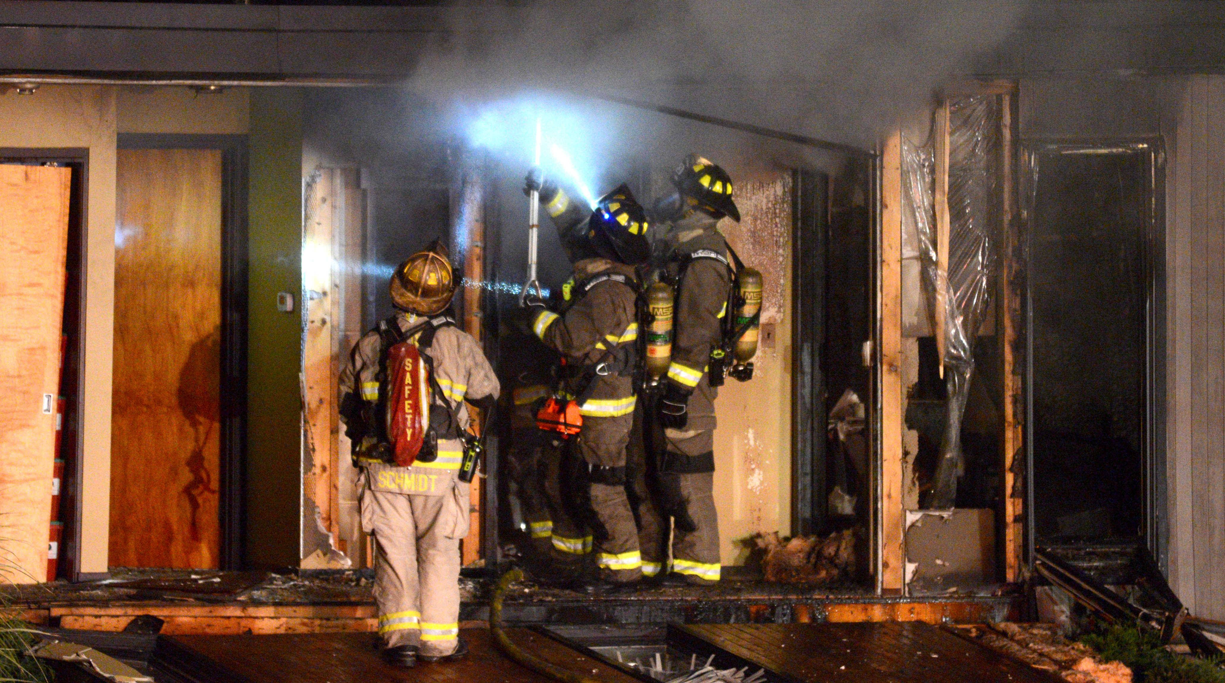 Firefighters work the scene of an explosion Monday night on the 1100 block of Morningside Drive in Elgin.