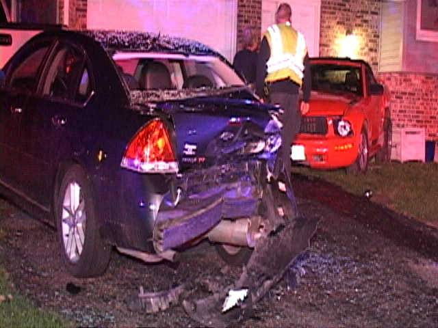 The driver of a red Mustang lost control Sunday night, striking multiple parked cars and a house in Woodridge, police say. Nobody was seriously injured.