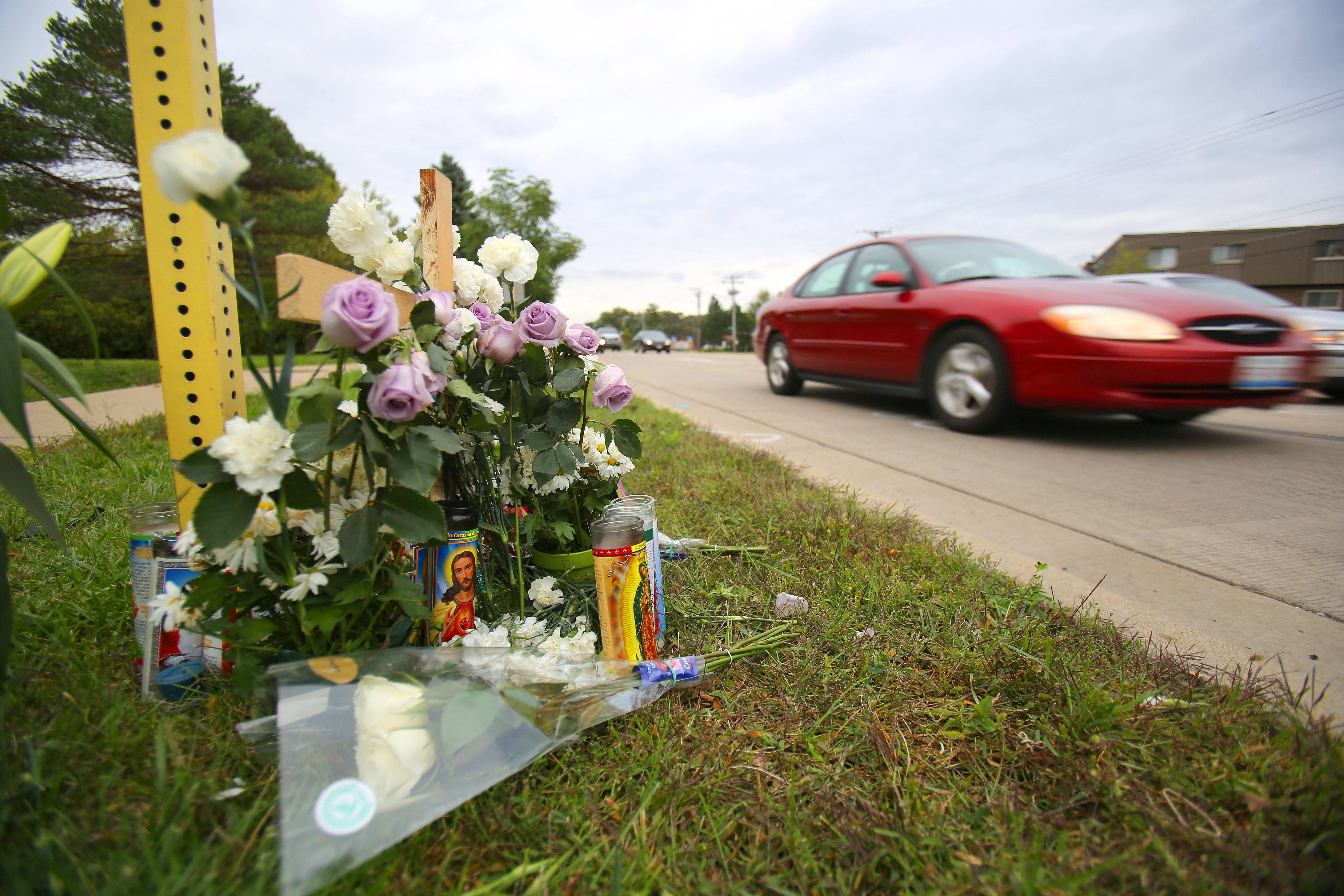 A memorial sits on McHenry Road in Wheeling for Fredi Morales, the Des Plaines man killed early Sunday when struck by a Wheeling police vehicle. The 22-year police veteran driving the vehicle was pursuing a suspected traffic violator when he struck Morales, police said Monday.