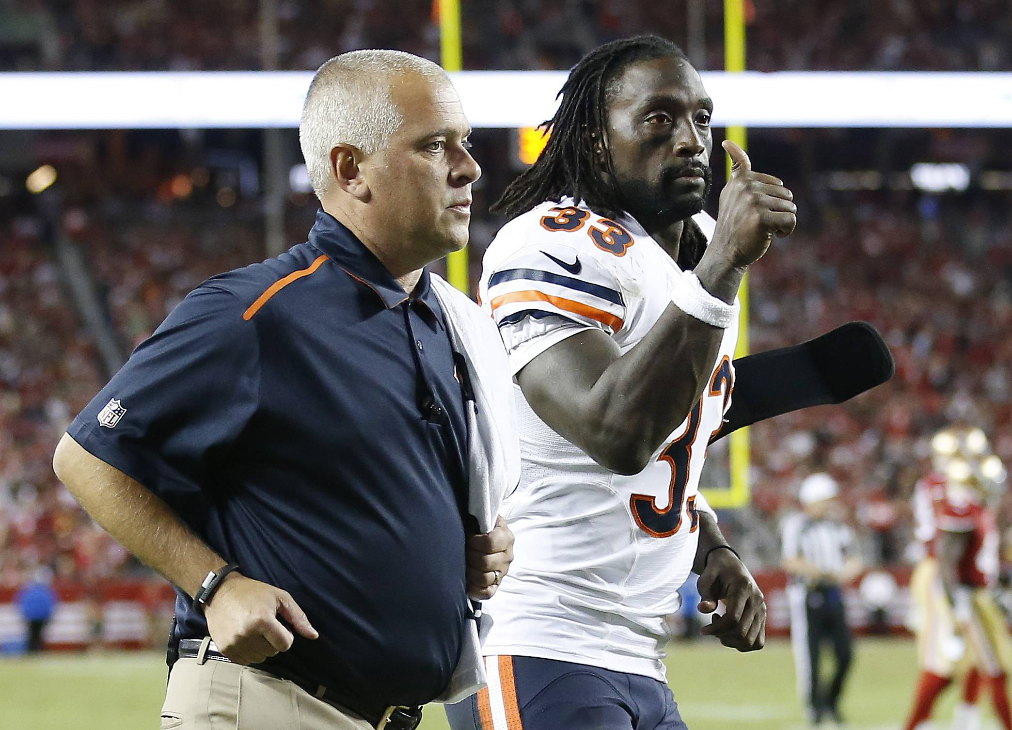 Bears cornerback Charles Tillman gives a thumbs-up as he leaves the field after being injured during the second half Sunday night. Tillman was put on injured reserve Monday with a ruptured triceps.