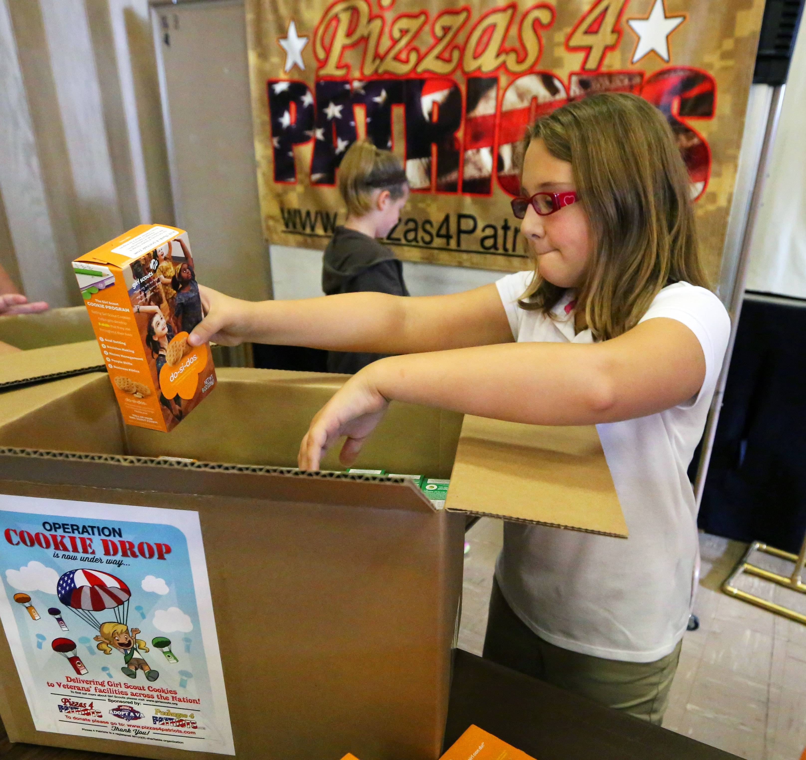 Mackenzie Nylander, 11, of Elk Grove Village, is part of the Girl Scouts' Operation Cookie Drop, which will deliver 13,000 boxes of cookies to veterans organizations in all 50 states.