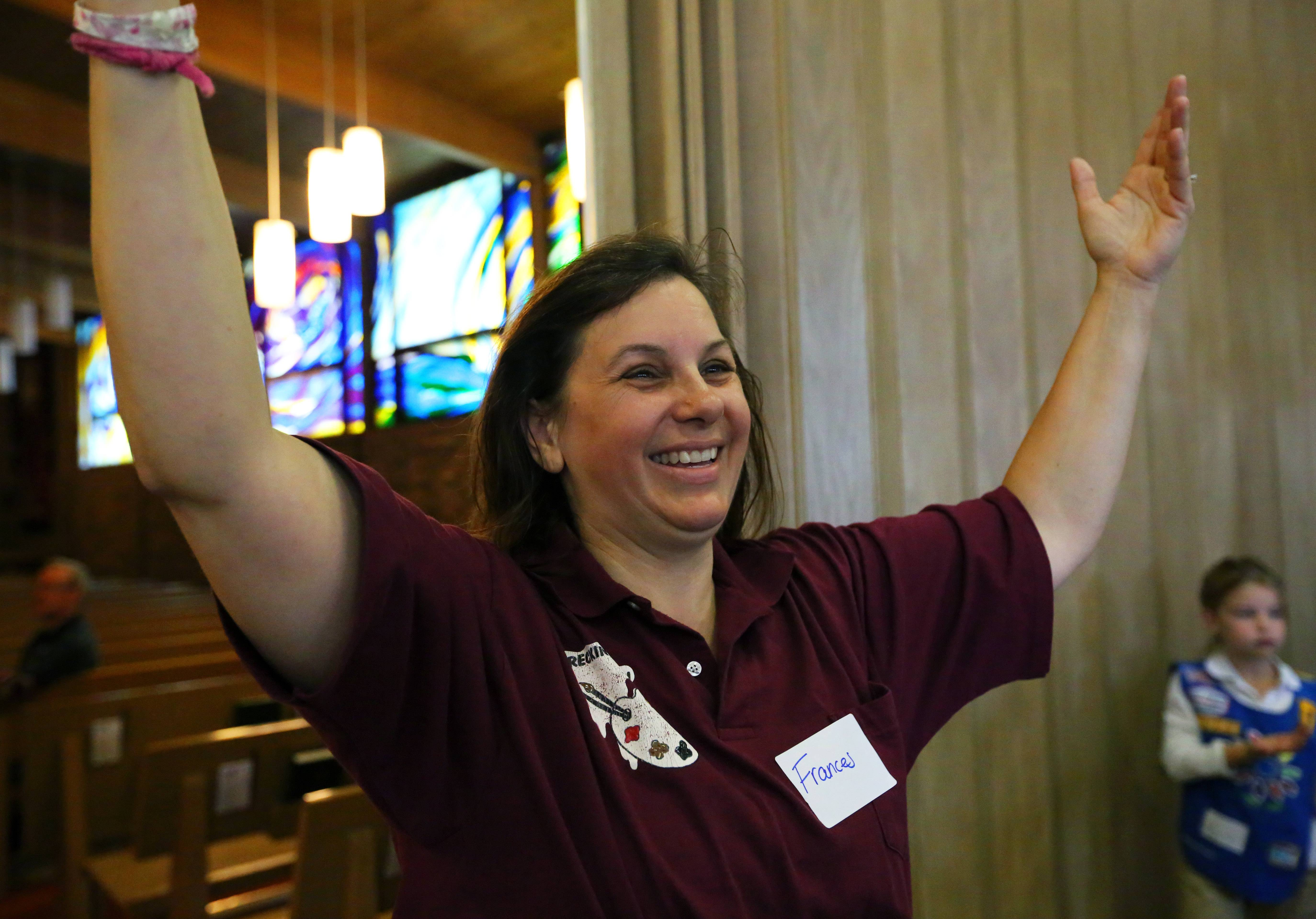 A jubilant Frances Lehning calls for a break Saturday at Lutheran Church of the Holy Spirit in Elk Grove Village. As part of Operation Cookie Drop, the local Scouts will ship 13,000 boxes of Girl Scout cookies to veteran organizations in all 50 states.
