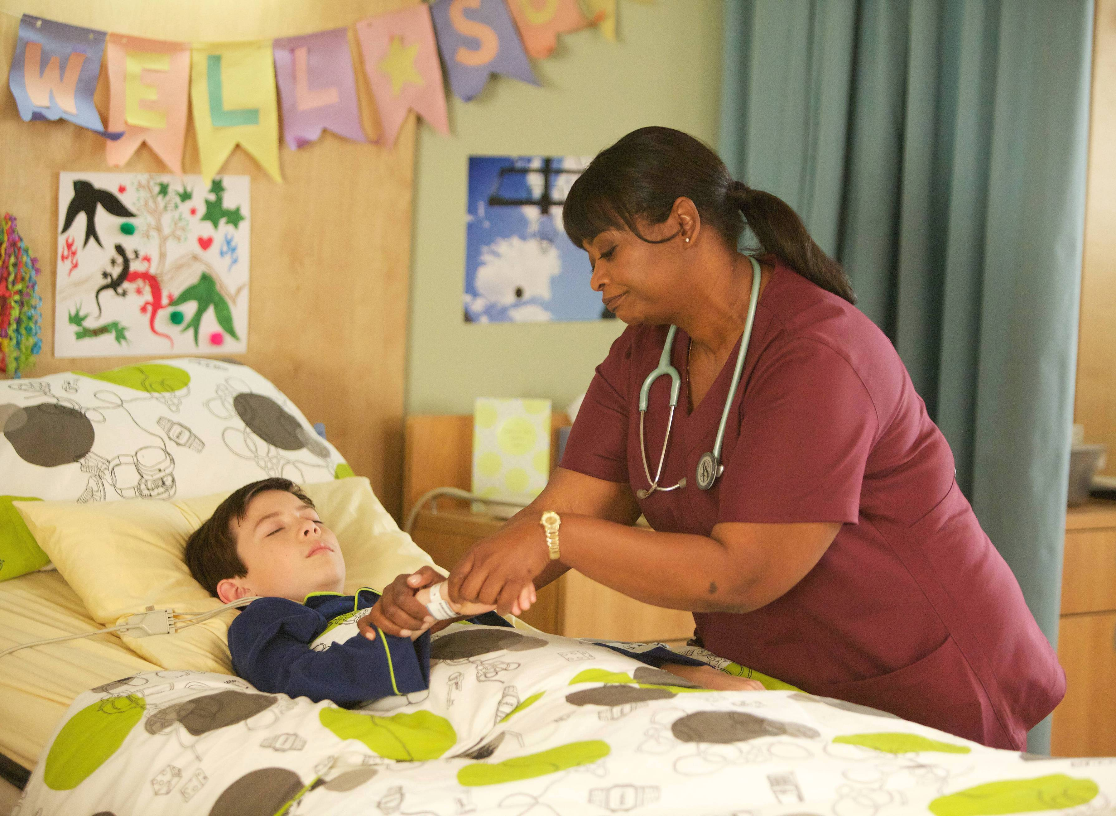 "Nurse Jackson (Octavia Spencer) tends to Charlie (Griffin Gluck) in Fox's new series ""Red Band Society,"" premiering at 8 p.m. Wednesday."
