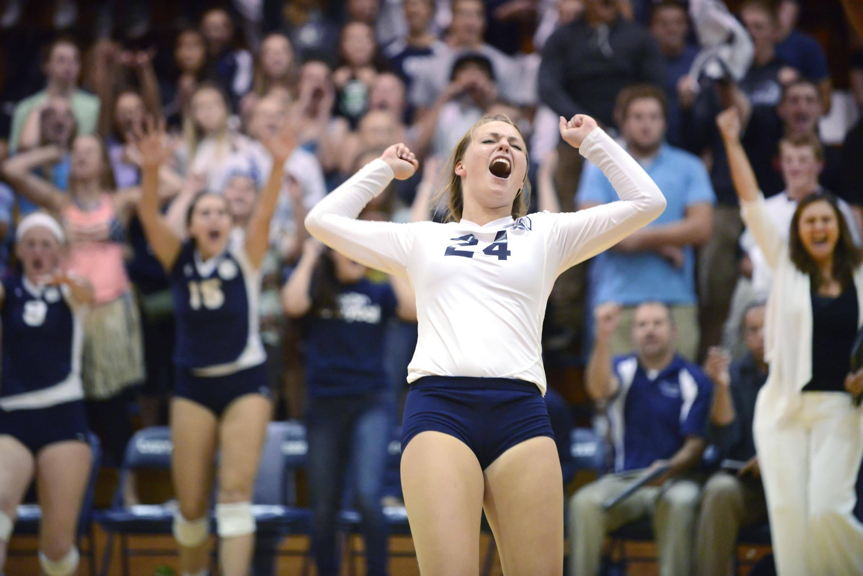Cary-Grove's Brianne Coffey and the home fans reacts to a winning point late in the second game against Crystal Lake South Thursday in Cary.