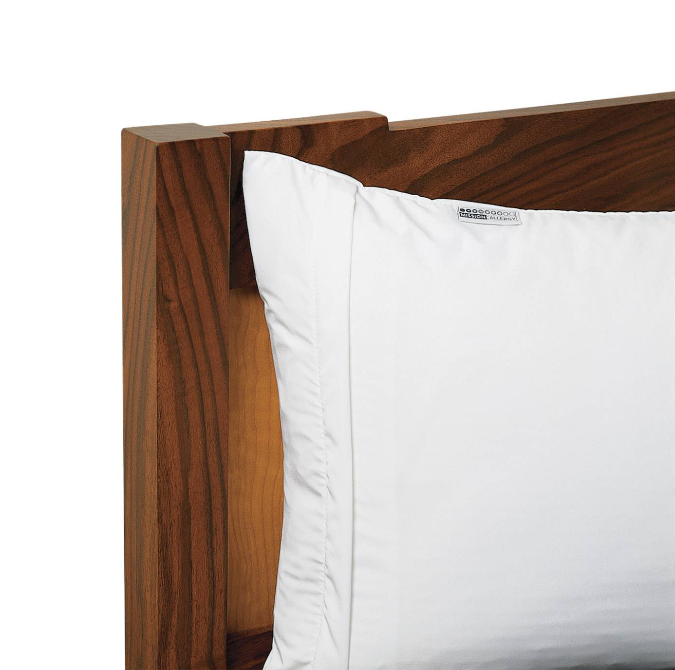 Lessen your allergies by encasing your pillow in an allergen-proof cover.