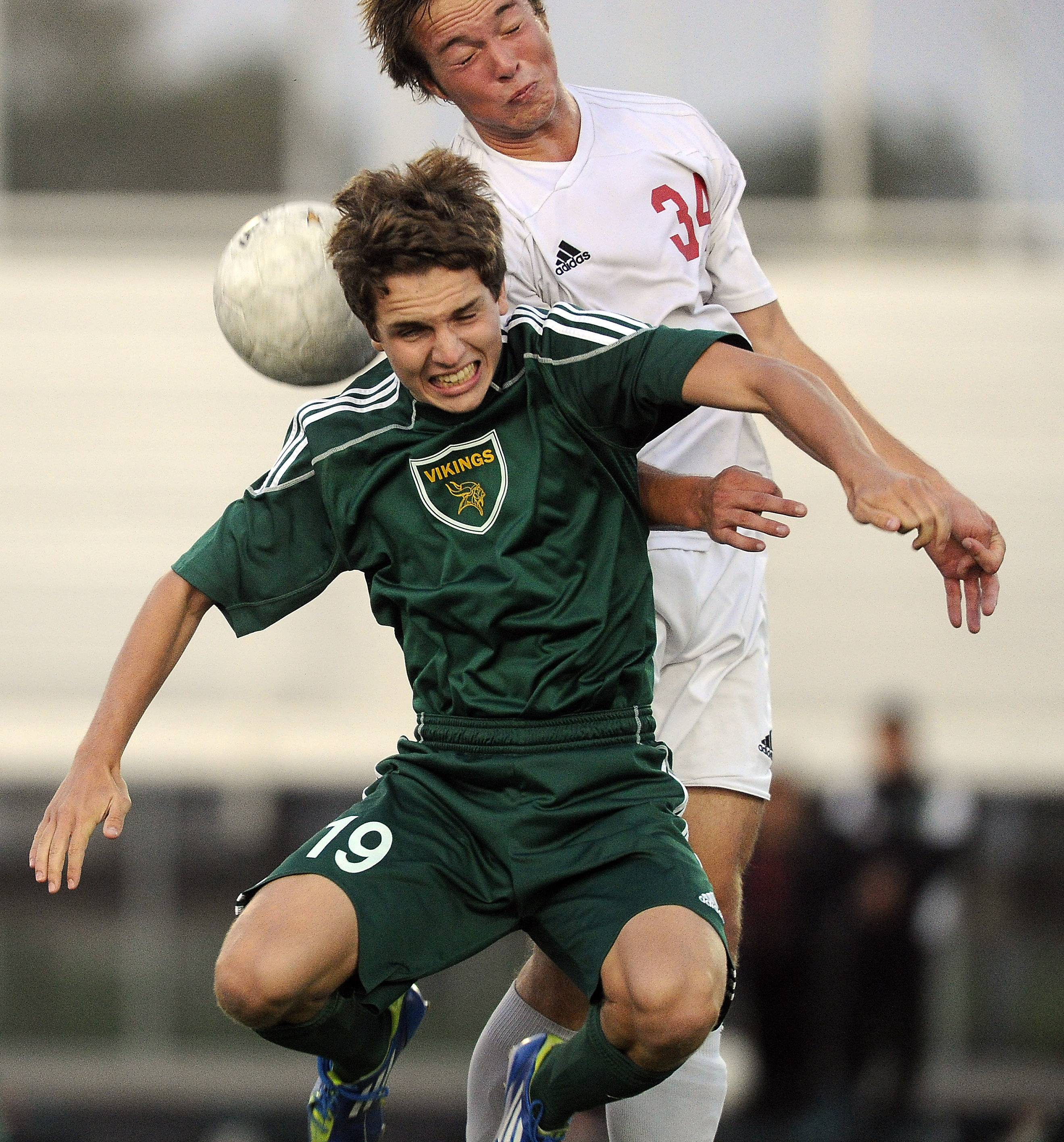 Palatine's Gavin Falotico and Fremd's Jake Arbour battle for the ball in the first half at Palatine on Thursday.