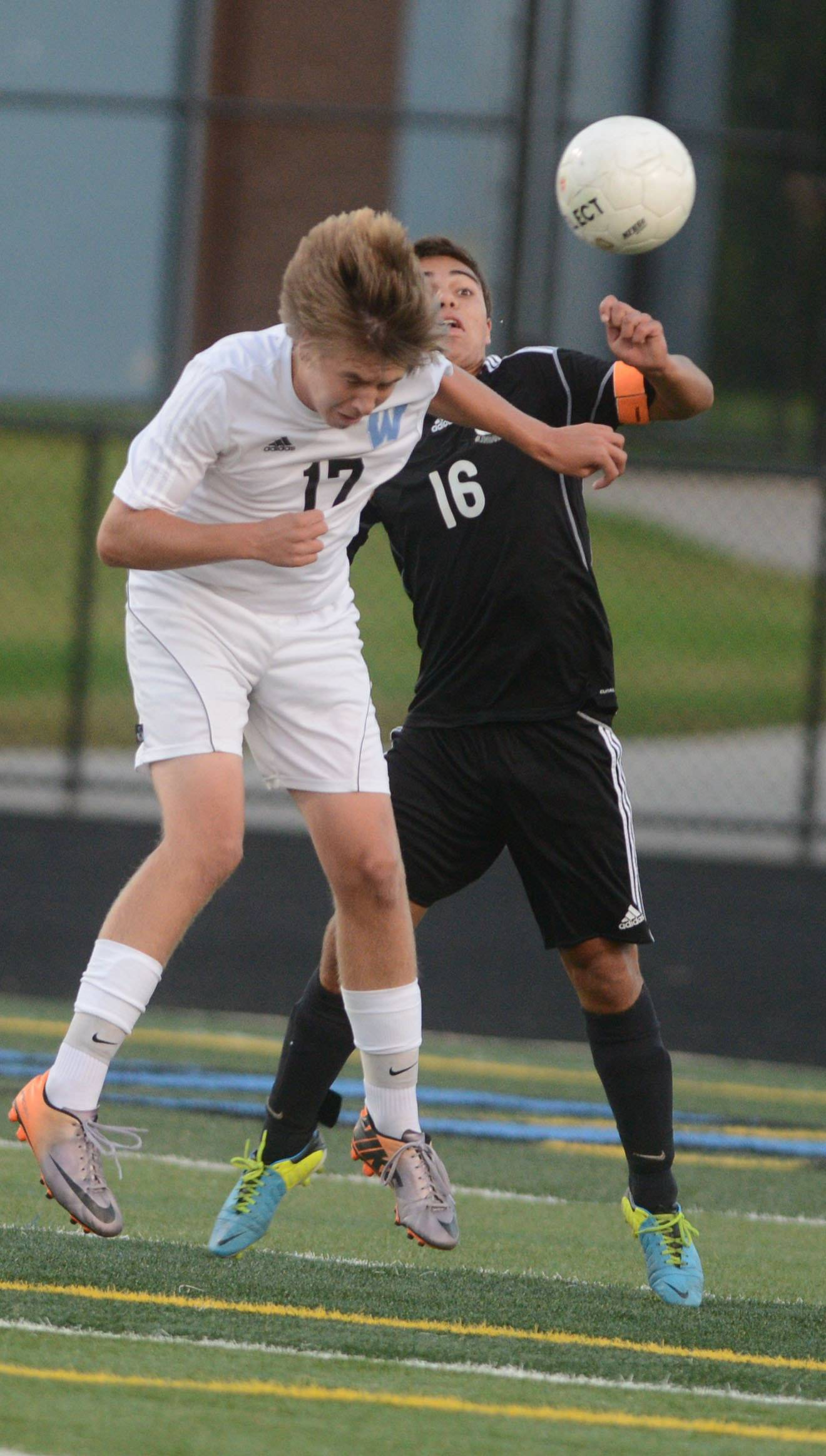 Lucas Betts of Willowbrook and William Lanzillo of Glenbard West vie for the ball during the Glenbard West at Willowbrook boys soccer game Thursday.