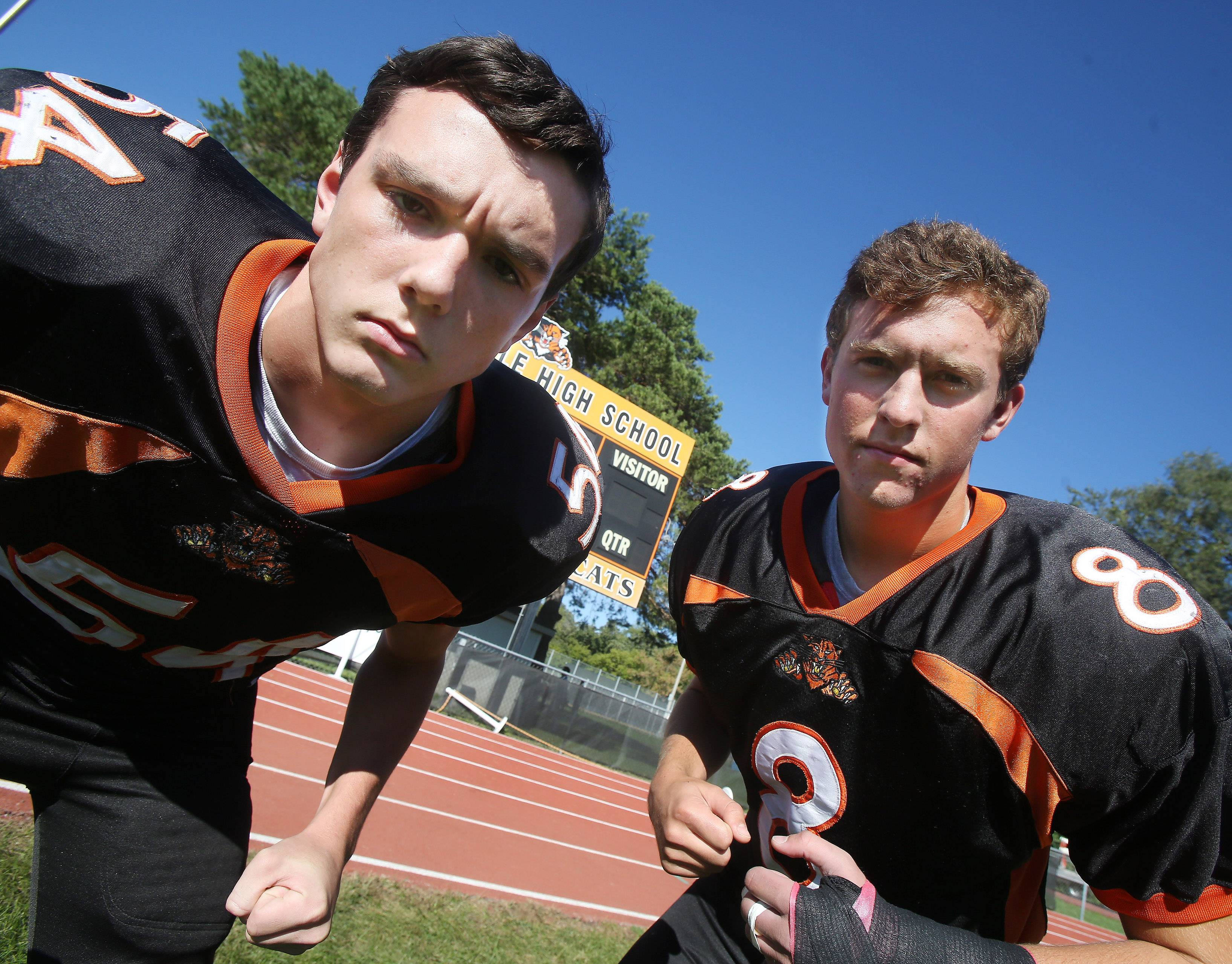 Defenders Jordan McInerney, left, and Ben Kimpler are setting a high standard for Libertyville's football team.