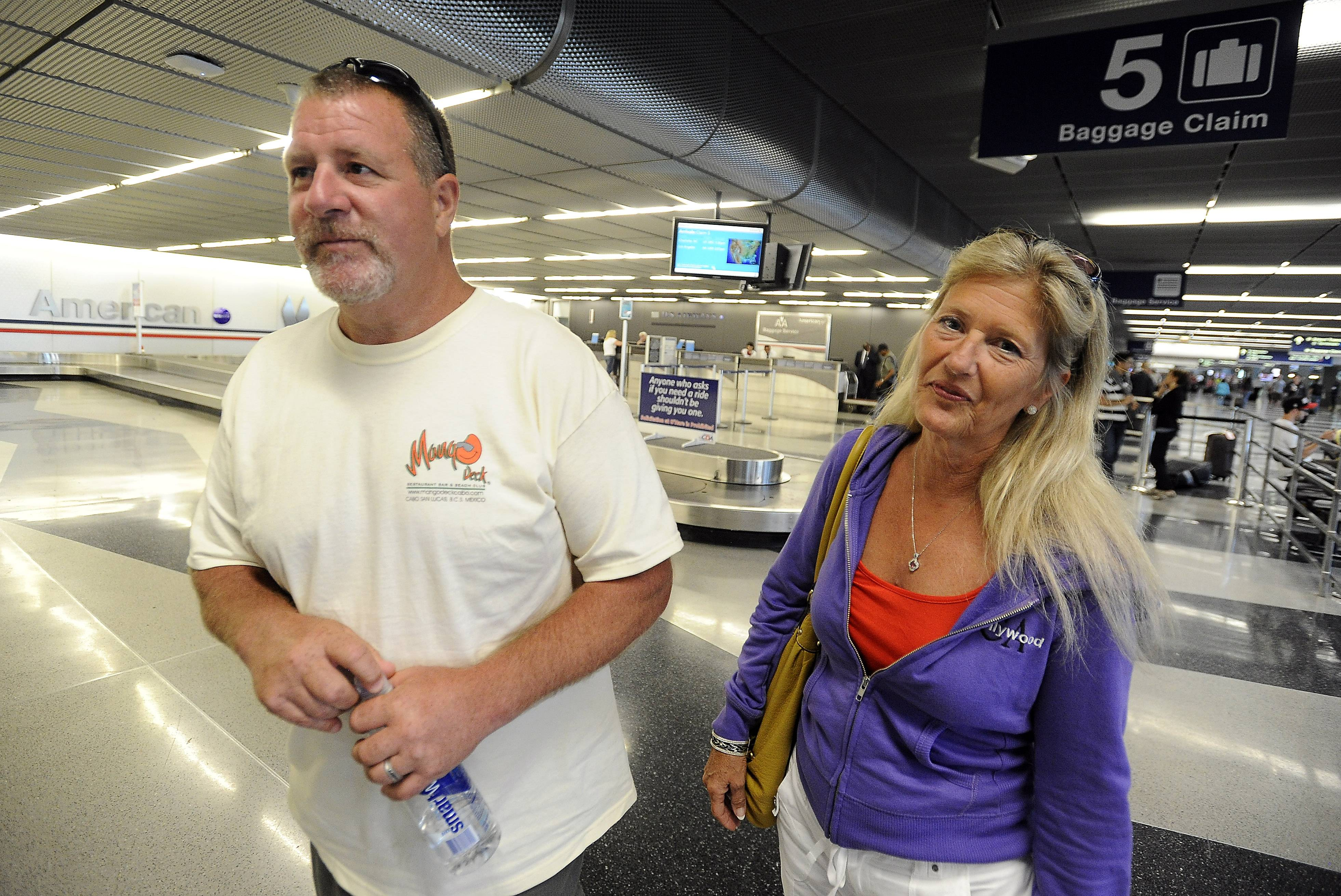 Hoffman Estates Fire Lt. Tom Mangiameli and his wife, Kathy, arrived Friday afternoon at O'Hare International Airport after being stuck in Los Cabos, Mexico, with several other firefighters who were there to attend the couple's wedding.