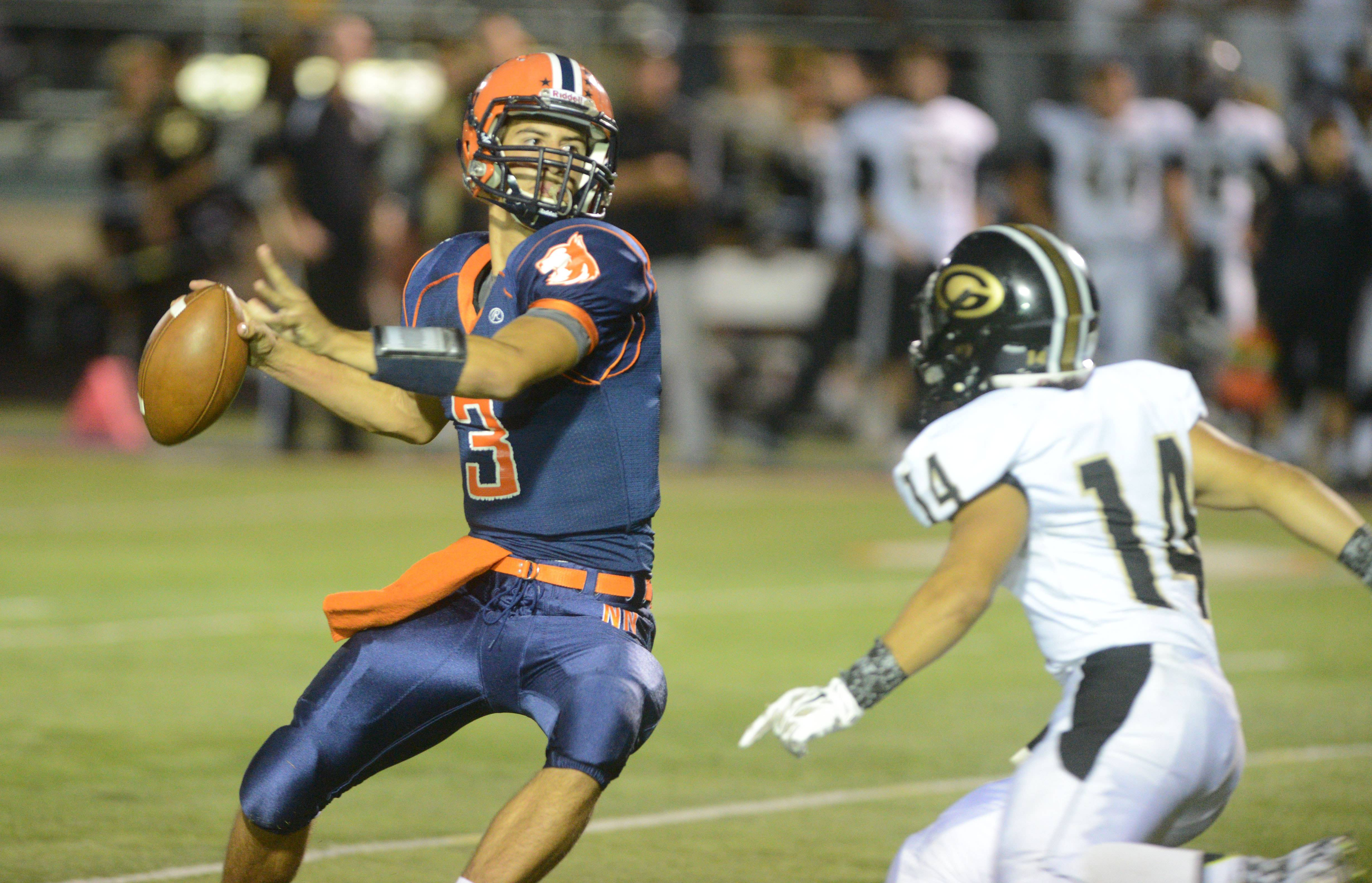 Chris Gajcak of Naperville North looks to pass as Phil Partipilo of Glenbard North moves in.